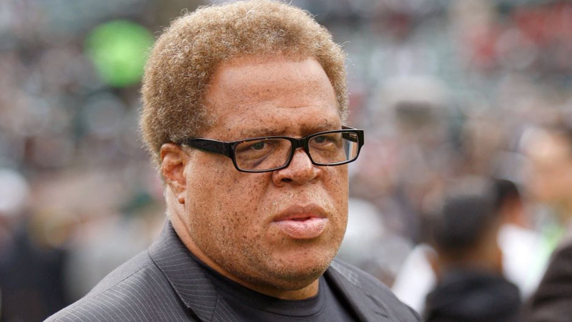 OAKLAND, CA - DECEMBER 7: General Manager Reggie McKenzie of the Oakland Raiders stands of the field prior to the game against the San Francisco 49ers at O.co Coliseum on December 7, 2014 in Oakland, California. The Raiders defeated the 49ers 24-13. (Photo by Michael Zagaris/San Francisco 49ers/Getty Images)