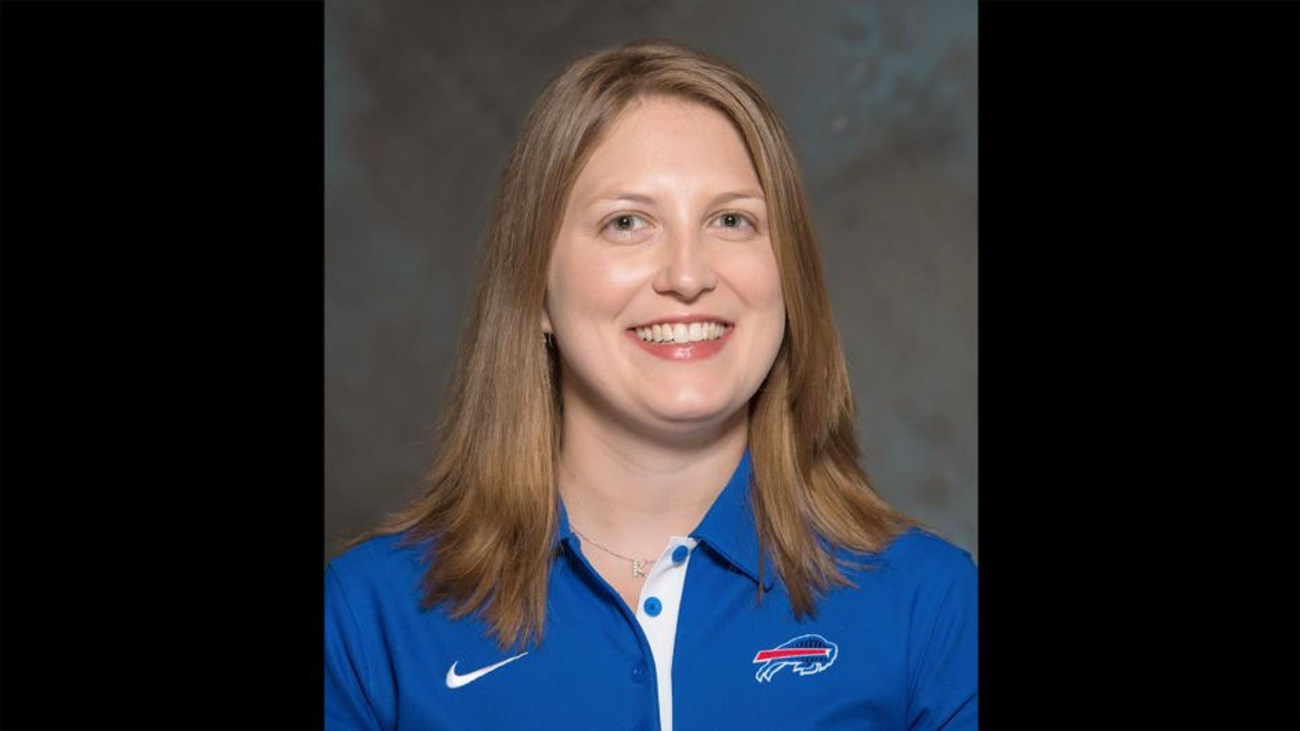 FILE - A May 2015 photo shows Kathryn Smith of the Buffalo Bills NFL football team. The Bills promoted Smith to be their special teams quality control coach, making her the first full-time female member of an NFL coaching staff. The team announced the move in a release Wednesday night, Jan. 20, 2016. Smith was an administrative assistant this season for Bills assistant coaches under Rex Ryan, with whom she has worked for seven years. (AP Photo/File)