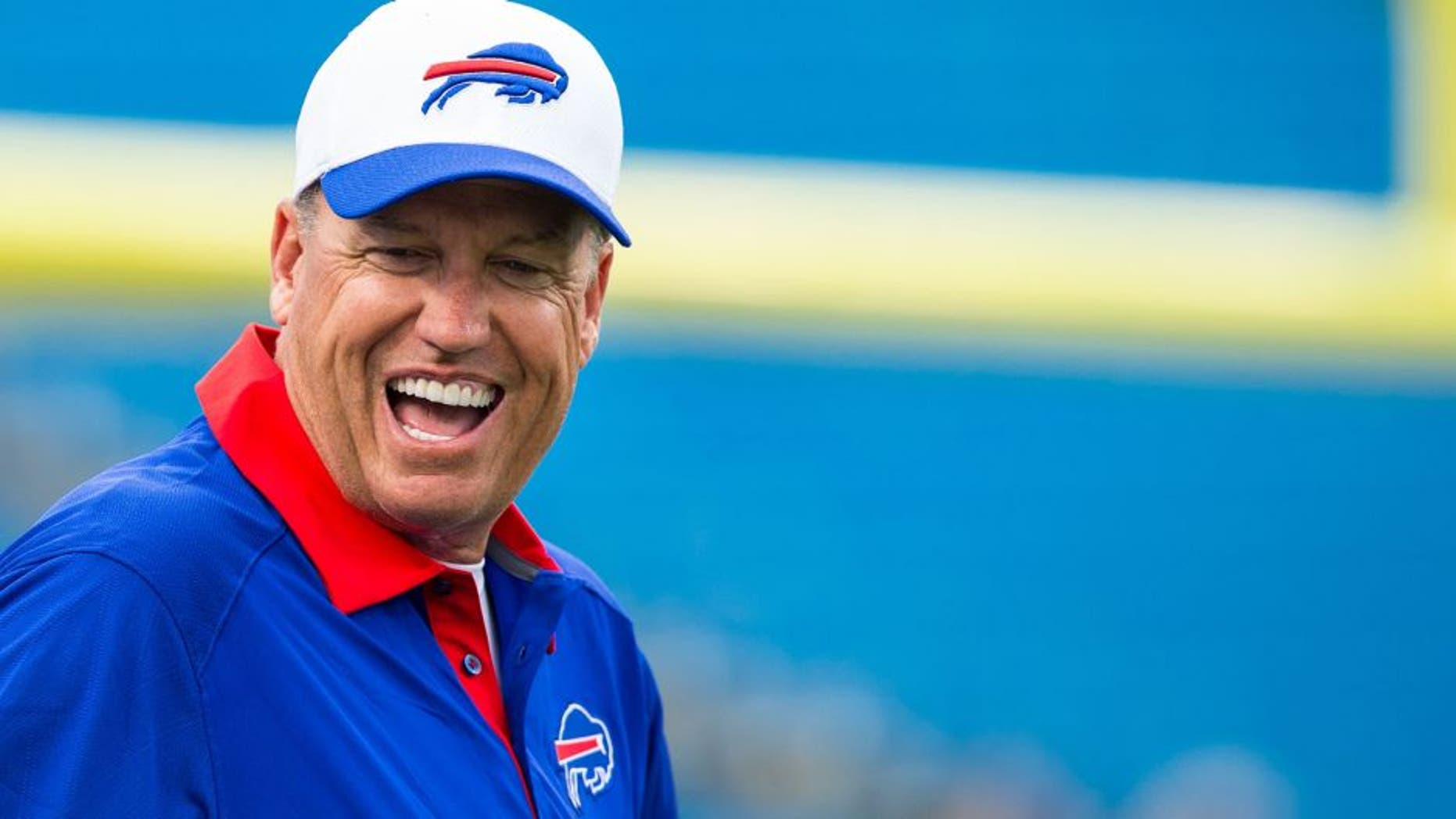 ORCHARD PARK, NY - AUGUST 14: Head coach Rex Ryan of the Buffalo Bills laughs with players before the game against the Carolina Panthers on August 14, 2015 at Ralph Wilson Stadium in Orchard Park, New York. (Photo by Brett Carlsen/Getty Images)