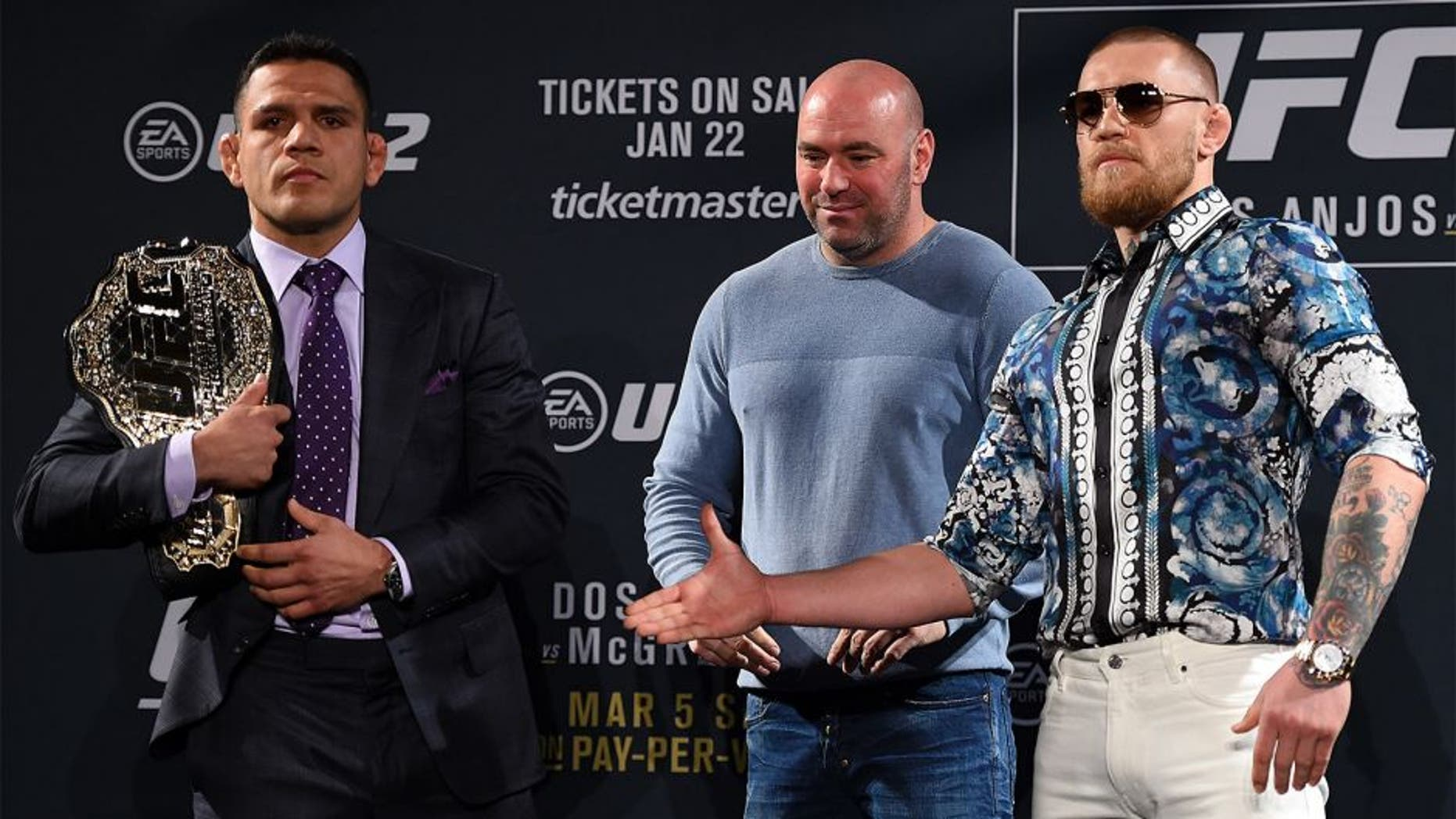 LAS VEGAS, NV - JANUARY 20: UFC President Dana White squares off Rafael dos Anjos of Brazil (L) and Conor McGregor of Ireland (R) during the UFC 197 on-sale press conference event inside MGM Grand Hotel & Casino on January 20, 2016 in Las Vegas, Nevada. (Photo by Jeff Bottari/Zuffa LLC/Zuffa LLC via Getty Images)
