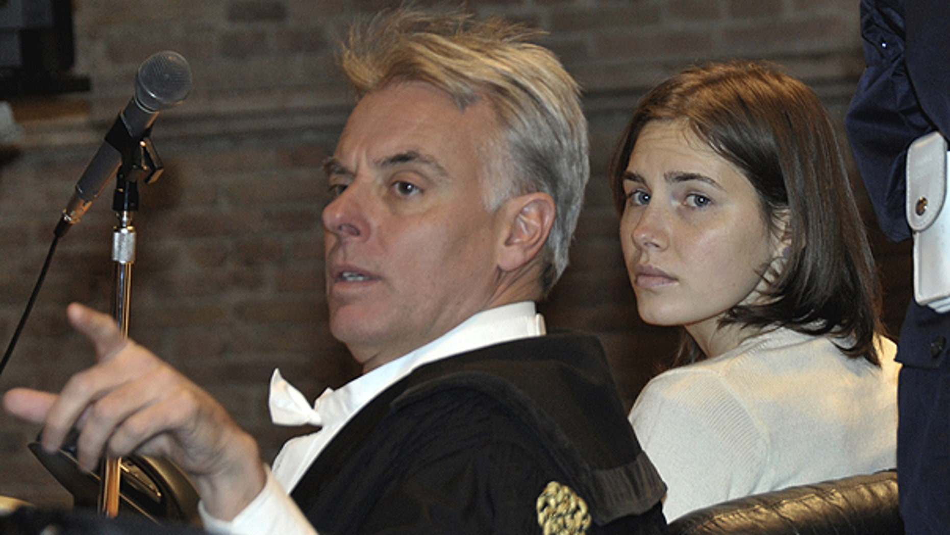 Jan. 22: Convicted U.S. student Amanda Knox, right, and her lawyer Carlo Dalla Vedova look on as they attend a hearing in her appeal trial, at Perugia's courthouse, Italy.