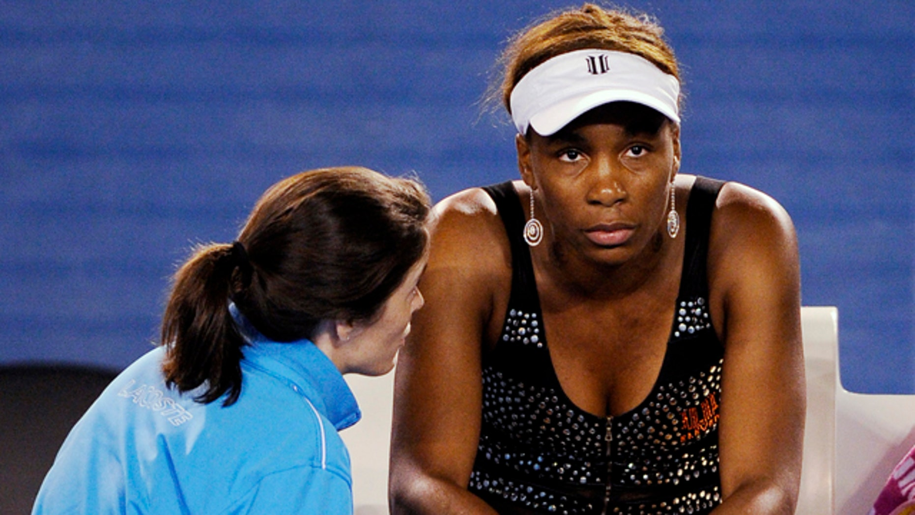 Jan. 21: Venus Williams is spoken to by a trainer before she withdrew from her third round match against Germany's Andrea Petkovic with an injury at the Australian Open tennis championships in Melbourne, Australia.