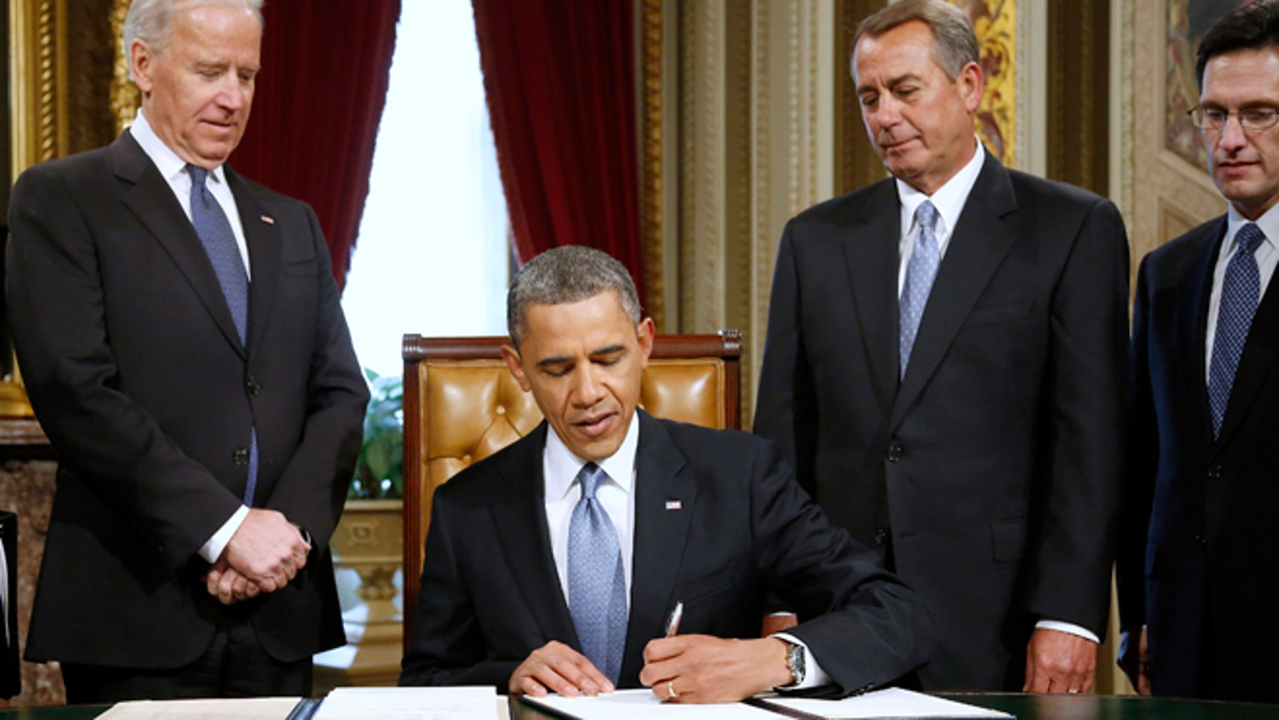 Jan. 21, 2013: President Barack Obama signs a proclamation to commemorate the inauguration, entitled a National Day of Hope and Resolve, on Capitol Hill in Washington.
