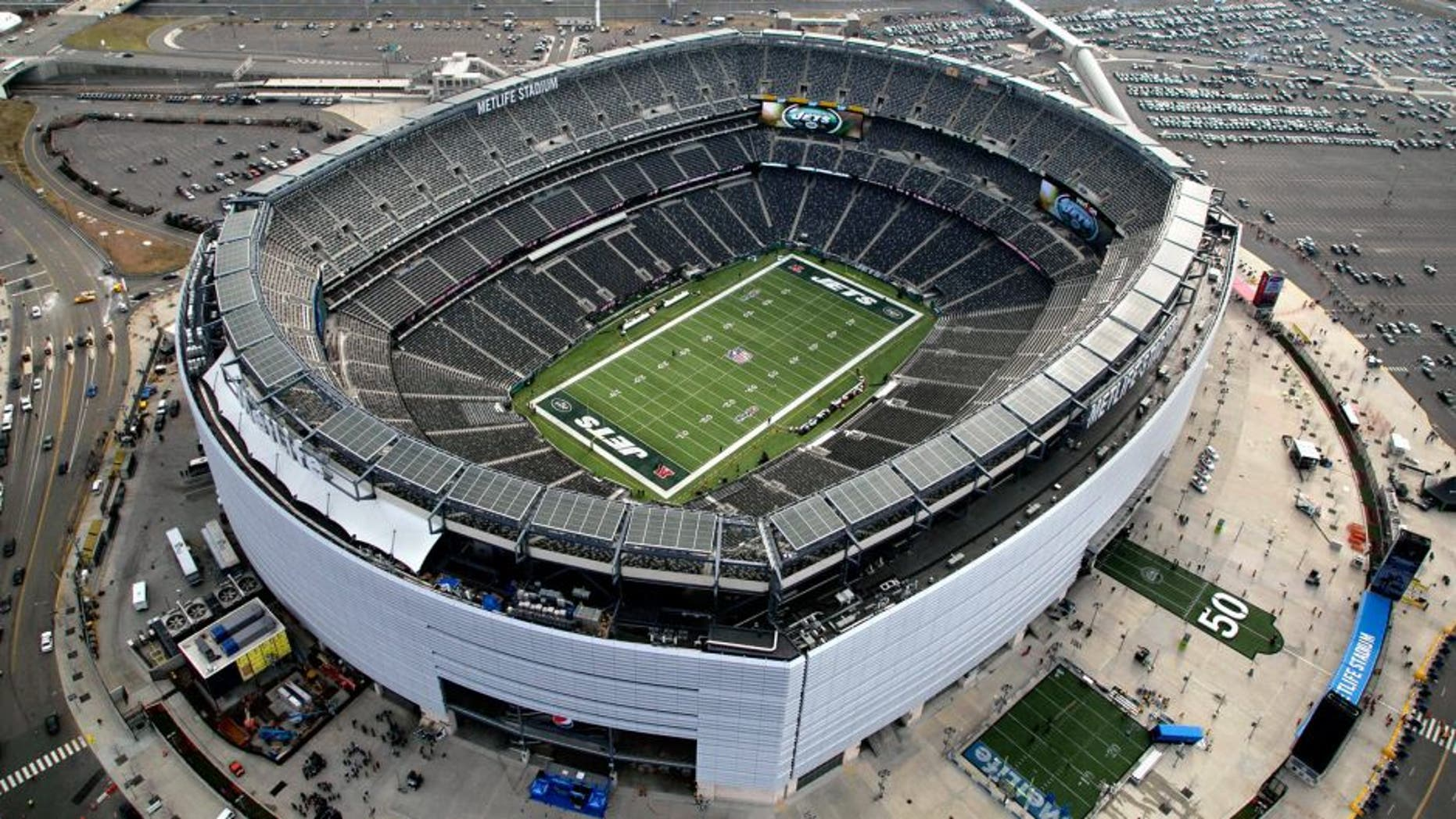 In this Dec. 1, 2013, photo, MetLife Stadium is seen in an aerial photo in East Rutherford, N.J. Super Bowl tickets are tough to acquire. There's only so many seats in the stadium, and several are filled by corporations and sponsors. Then, when you factor in price and logistics, it makes it all that more difficult, even with the rise of the secondary market on the internet. Things won't be any easier this year, as the NFL houses its first cold-weather Super Bowl on Feb. 2 at MetLife Stadium with the New York skyline as a backdrop. (AP Photo/Mark Lennihan)
