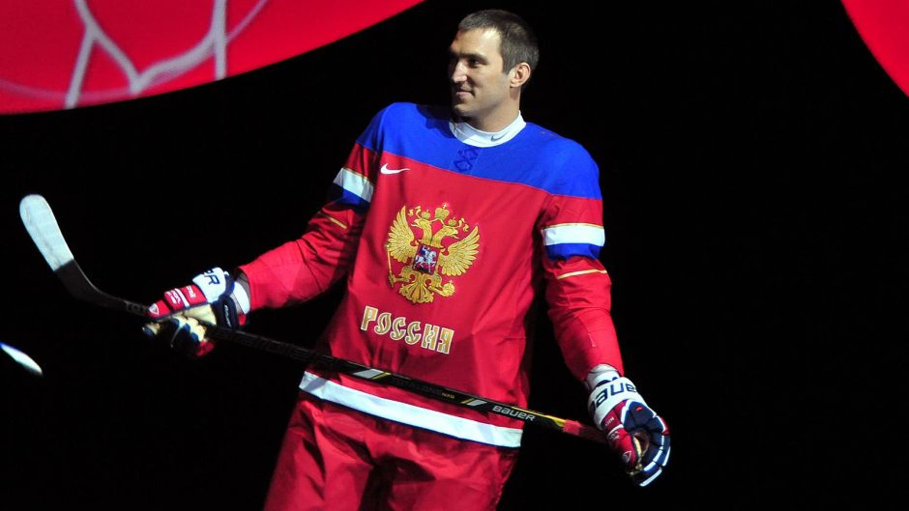 Russian national ice hockey team and the Washington Capitals forward Alexander Ovechkin introduce the new Russian Ice Hockey Olympic team uniform in Moscow, on August 26, 2013. AFP PHOTO / ALEXANDER KAZAKOV (Photo credit should read ALEXANDER KAZAKOV/AFP/Getty Images)