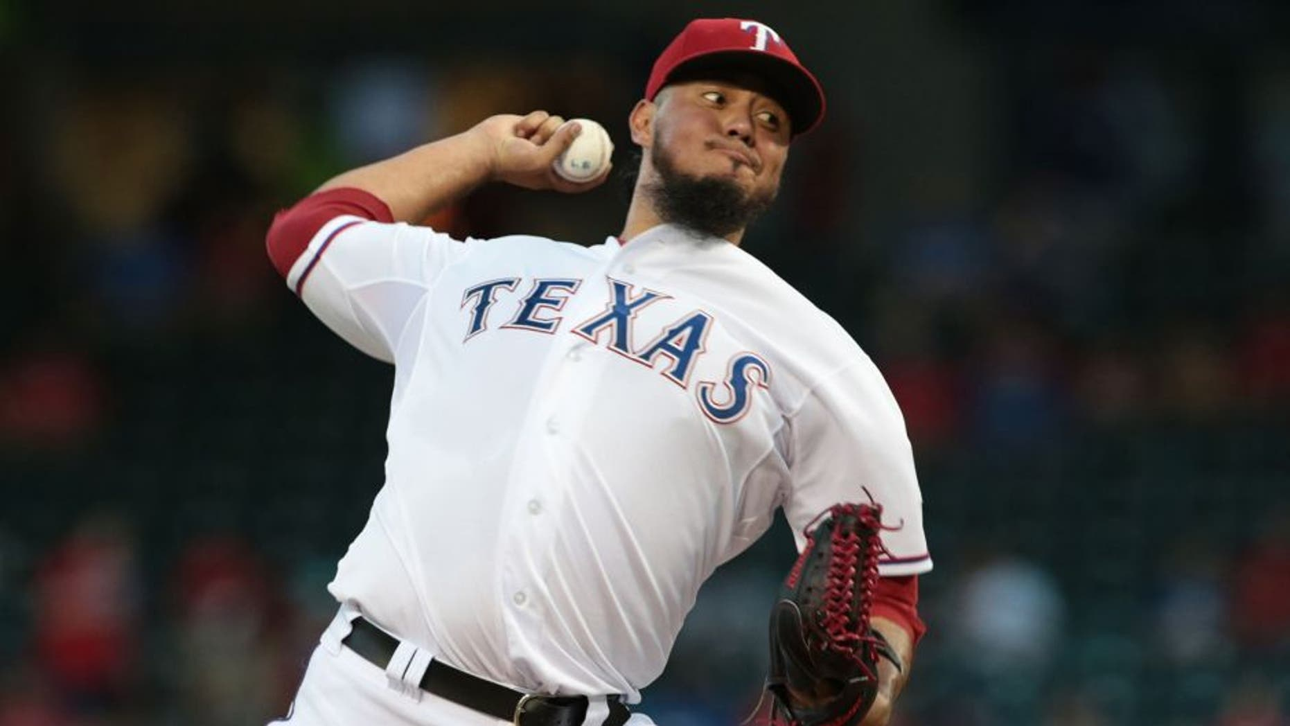 ARLINGTON, TX - SEPTEMBER 18: Yovani Gallardo #49 of the Texas Rangers throws in the first inning Seattle Mariners at Global Life Park in Arlington on September 18, 2015 in Arlington, Texas. (Photo by Rick Yeatts/Getty Images)