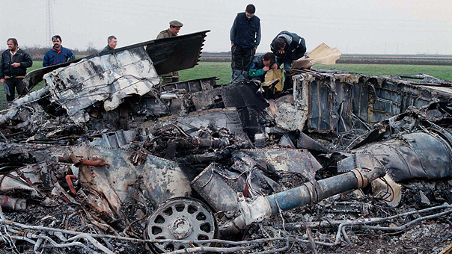 In this March 28, 1999 file photo, Yugoslav army experts check the wreckage of a downed American F-117 aircraft, in the village of Budjanovci, 30 miles northwest of Belgrade.