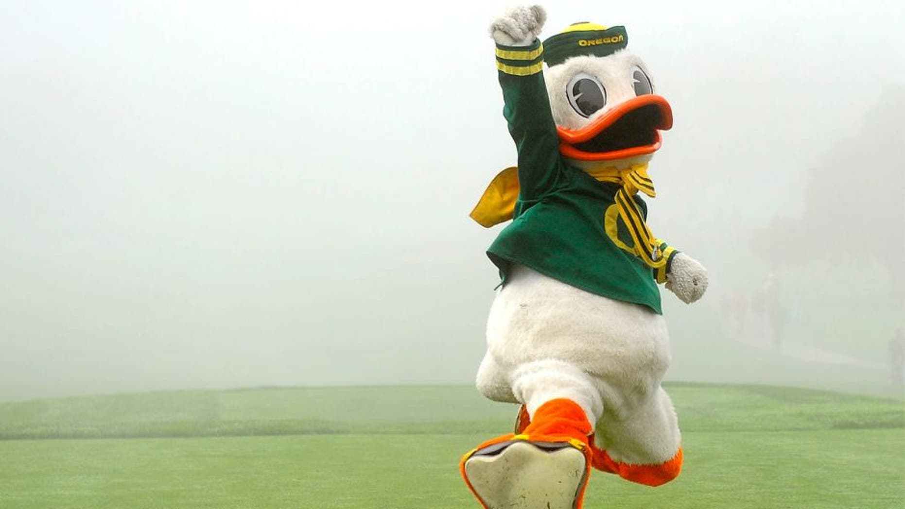 January 26, 2013; La Jolla, CA, USA; The Oregon Ducks mascot celebrates after winning a dance competition during a fog delay before the start of the third round of the Farmers Insurance Open at Torrey Pines. Mandatory Credit: Photo By Christopher Hanewinckel-USA TODAY Sports