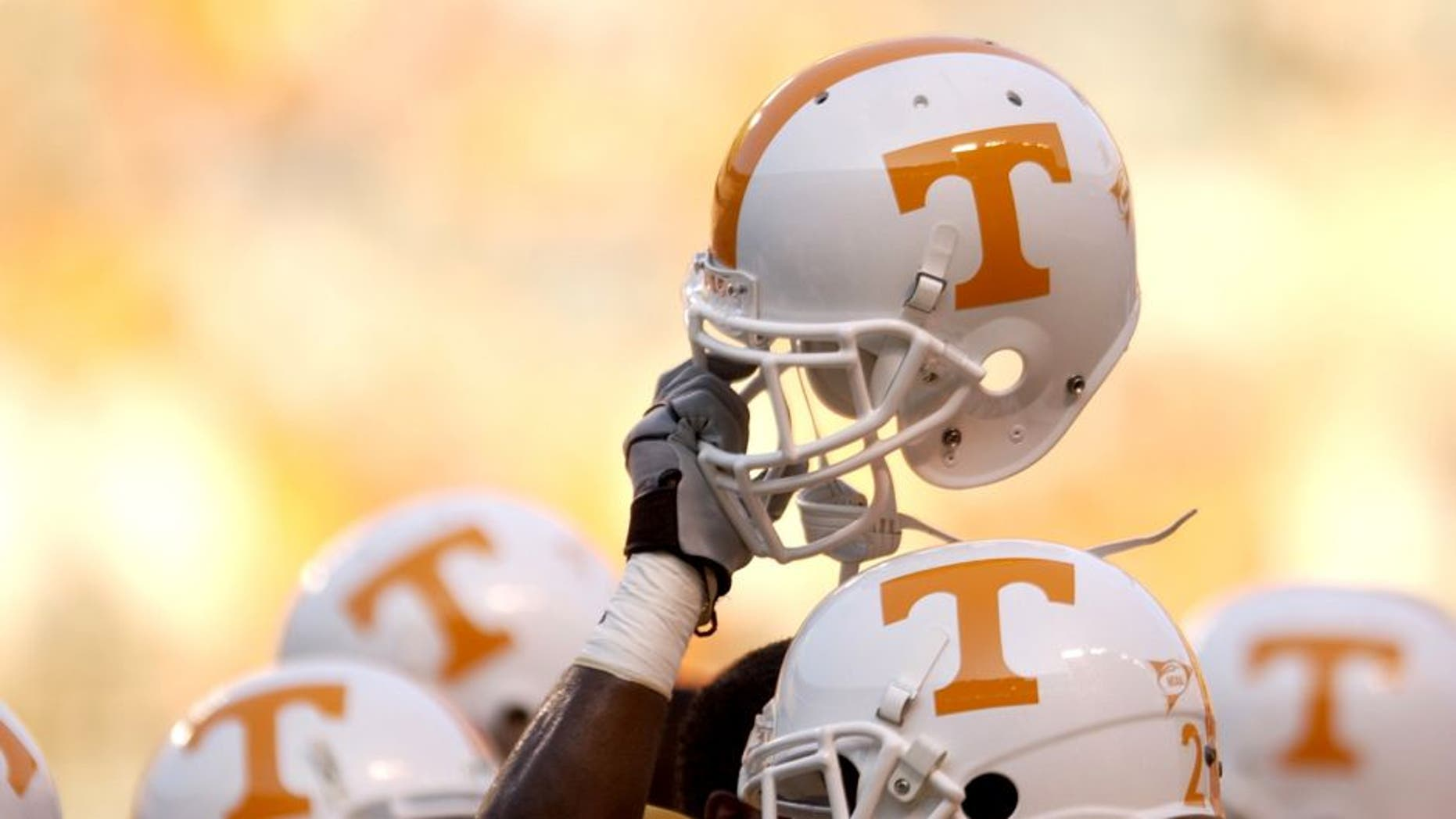 KNOXVILLE, TN - SEPTEMBER 7: A Tennessee Volunteer holds up his helmet in the team huddle before the NCAA football game against the Middle Tennessee State Blue Raiders at Neyland Stadium on September 7, 2002 in Knoxville, Tennessee. Tennessee won 26-3. (Photo by Elsa/Getty Images)