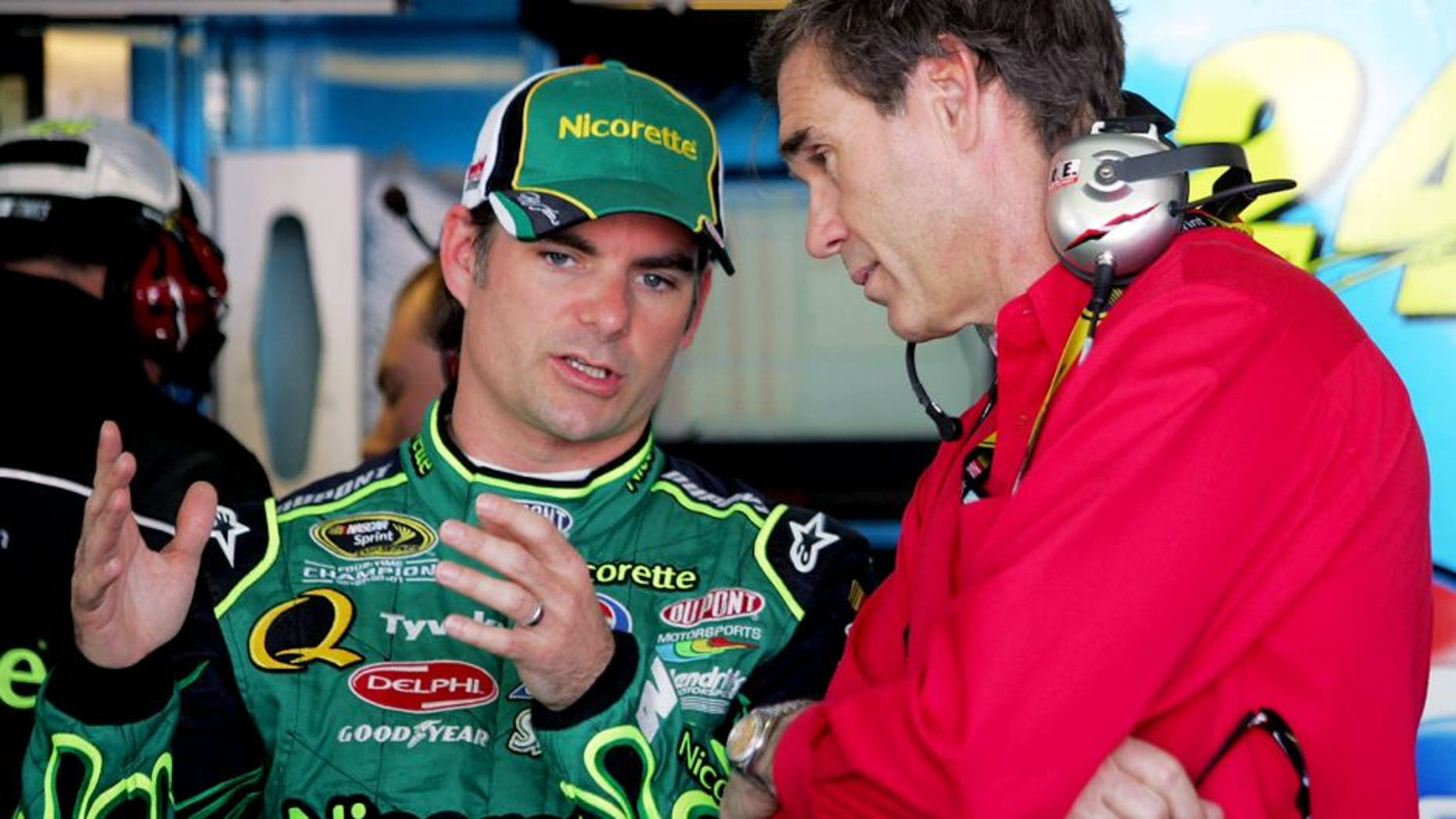 AVONDALE, AZ - APRIL 10: (L-R) Jeff Gordon, driver of the #24 Dupont/Nicorette Chevrolet, talks with Ray Evernham, NASCAR team owner for Gillett Evernham Motorsports, during practice for the NASCAR Sprint Cup Series Subway Fresh Fit 500 at Phoenix International Raceway on April 10, 2008 in Avondale, Arizona. (Photo by Todd Warshaw/Getty Images for NASCAR)