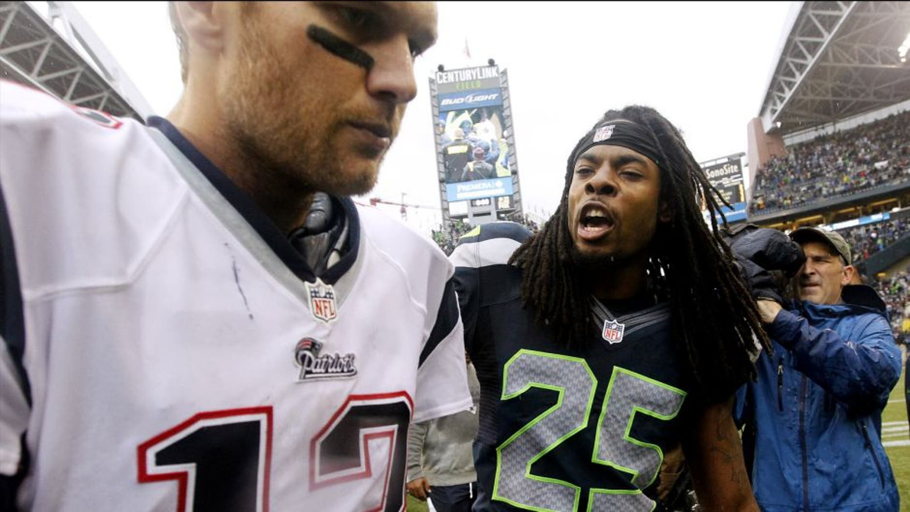 Seattle Seahawks' Richard Sherman (25) talks with New England Patriots quarterback Tom Brady after an NFL football game, Sunday, Oct. 14, 2012, in Seattle. The Seahawks won 24-23. (AP Photo/Elaine Thompson)