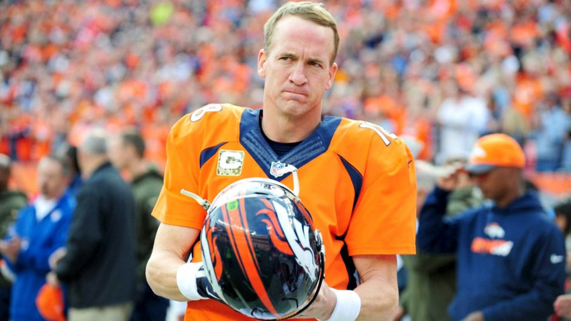 Nov 15, 2015; Denver, CO, USA; Denver Broncos quarterback Peyton Manning (18) before the game against the Kansas City Chiefs at Sports Authority Field at Mile High. Mandatory Credit: Ron Chenoy-USA TODAY Sports