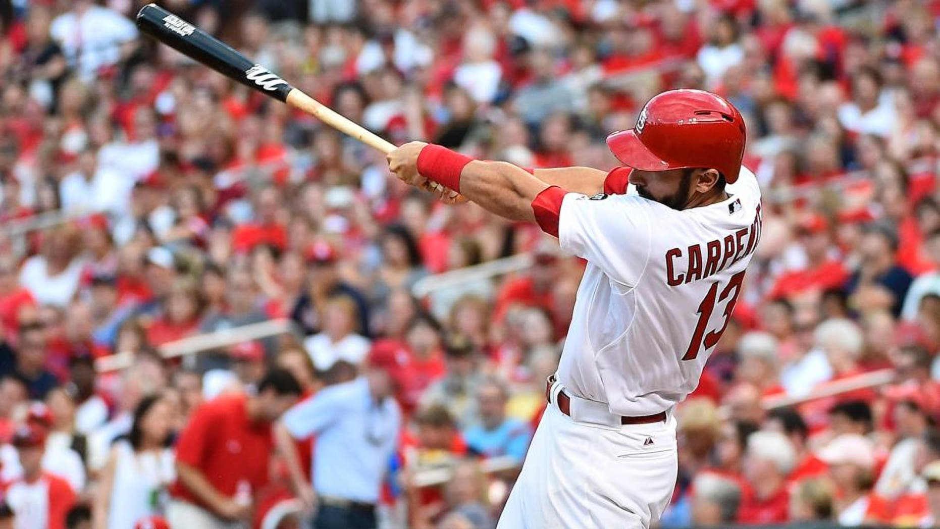 Jul 30, 2015; St. Louis, MO, USA; St. Louis Cardinals third baseman Matt Carpenter (13) connects for a three-run home run off of Colorado Rockies starting pitcher Chris Rusin (not pictured) in the second inning at Busch Stadium. Mandatory Credit: Jasen Vinlove-USA TODAY Sports