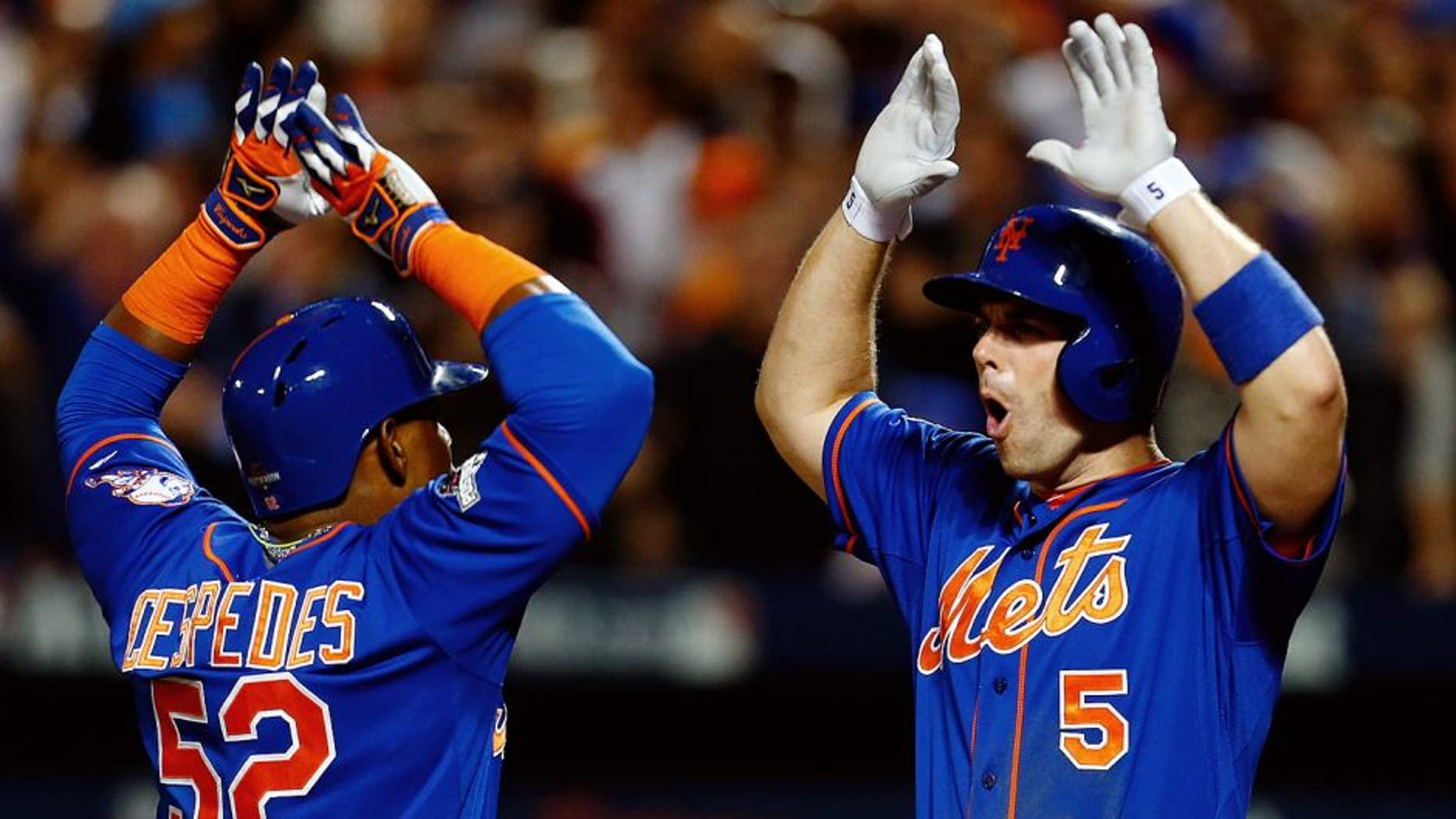NEW YORK, NY - OCTOBER 12: Yoenis Cespedes #52 of the New York Mets celebrates with David Wright #5 after hitting a three run home run against Alex Wood #57 of the Los Angeles Dodgers in the fourth inning during game three of the National League Division Series at Citi Field on October 12, 2015 in New York City. (Photo by Mike Stobe/Getty Images)
