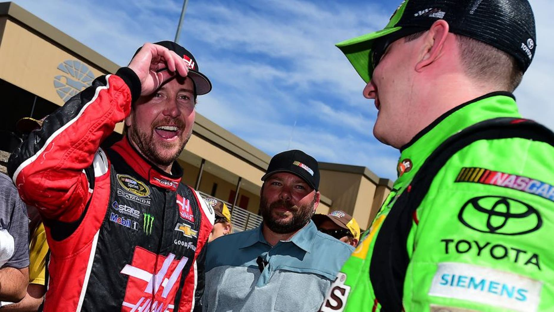 SONOMA, CA - JUNE 28: Kurt Busch, driver of the #41 Haas Automation Chevrolet, congratulates Kyle Busch, driver of the #18 M&M's Crispy Toyota, after winning the NASCAR Sprint Cup Series Toyota/Save Mart 350 at Sonoma Raceway on June 28, 2015 in Sonoma, California. (Photo by Jared C. Tilton/Getty Images)