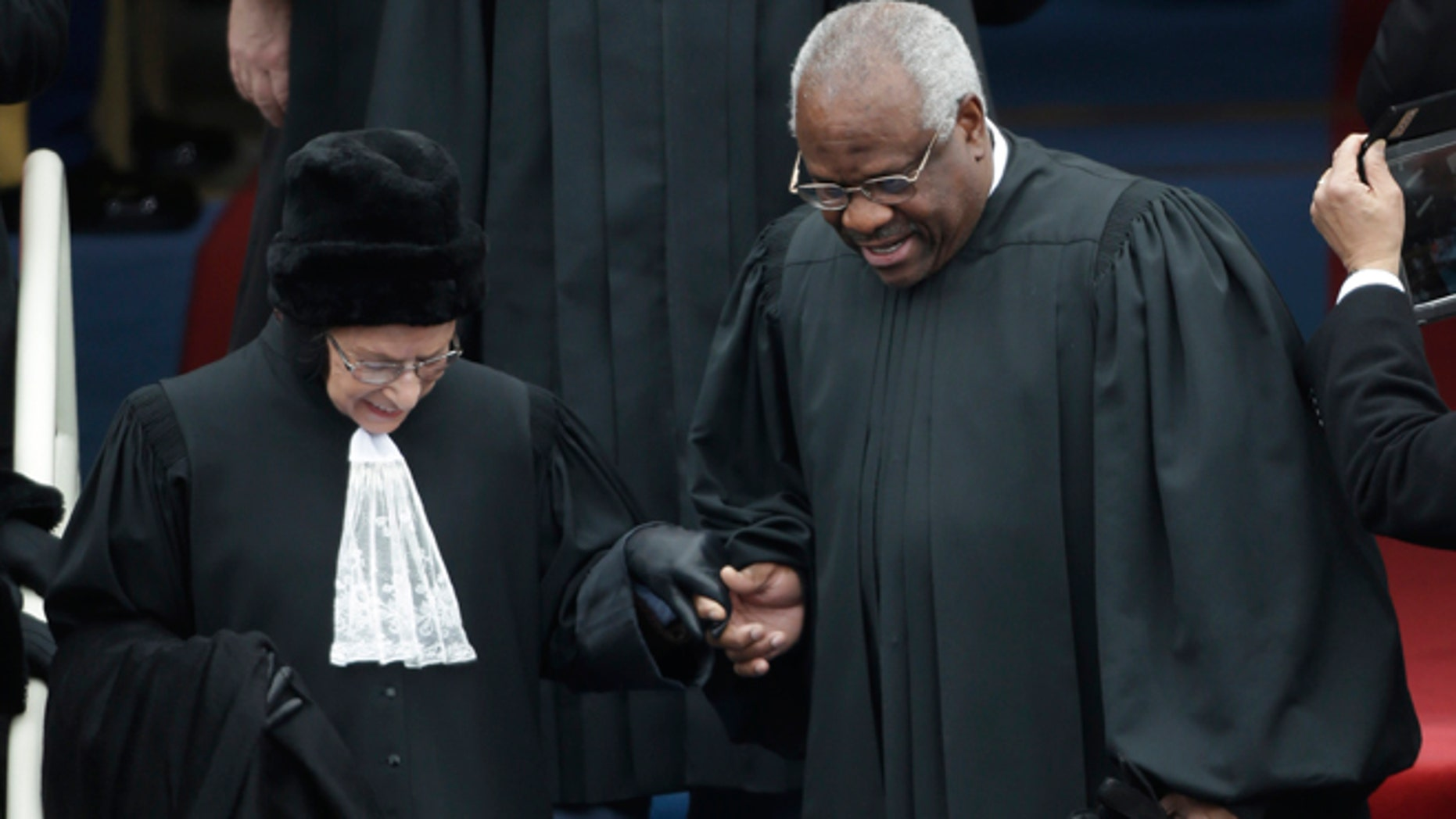 Jan. 21, 2013: Supreme Court associate justices Ruth Bader Ginsburg, left and Clarence Thomas arrive at the ceremonial swearing-in for President Barack Obama at the U.S. Capitol during the 57th Presidential Inauguration.