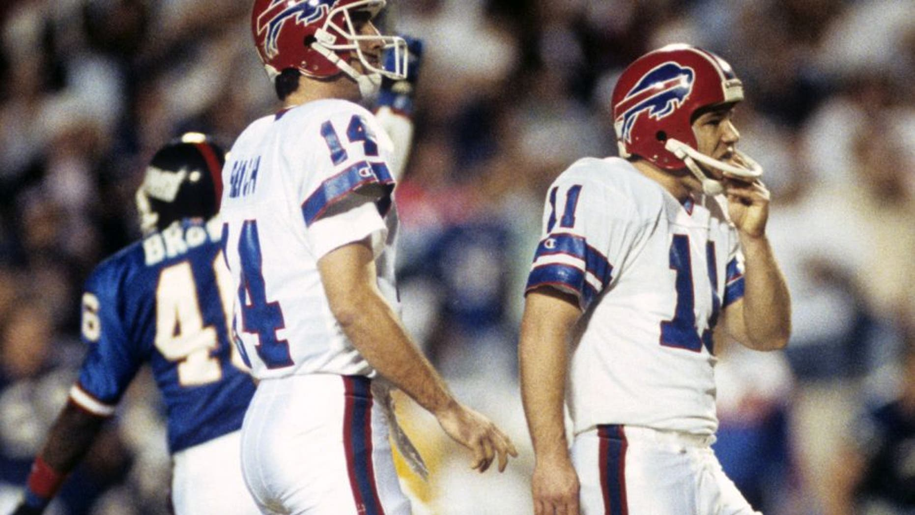 Buffalo Bills quarterback Frank Reich (14) and kicker Scott Norwood (11) watch in dismay as Norwood's last-second game-winning field goal attempt flies wide right during Super Bowl XXV, a 20-19 loss to the New York Giants on January 27, 1991, at Tampa Stadium in Tampa, Florida. (Photo by Rob Brown/Getty Images) *** Local Caption ***