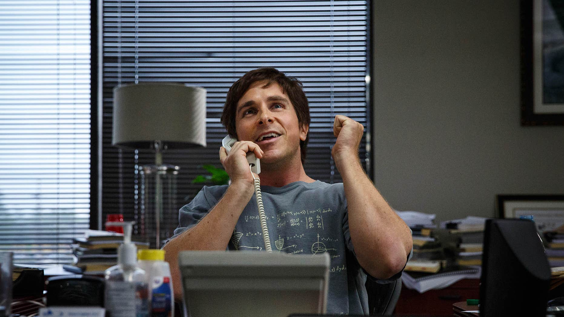 """FILE - In this file image released by Paramount Pictures, Christian Bale appears in a scene from """"The Big Short."""""""