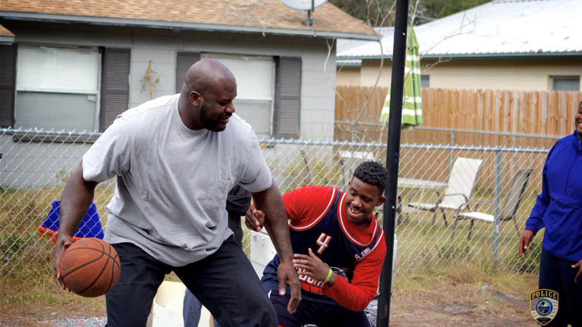 Shaquille O'Neal surprises Florida teens and officer with game of pickup basketball.