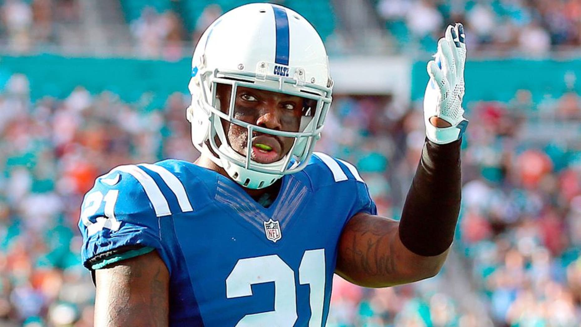 Dec 27, 2015; Miami Gardens, FL, USA; Indianapolis Colts cornerback Vontae Davis (21) waves to the crowd during the second half against the Miami Dolphins at Sun Life Stadium. The Colts won 18-12. Mandatory Credit: Steve Mitchell-USA TODAY Sports