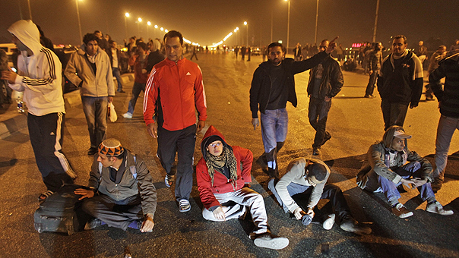 Jan. 26: Protesters stop traffic in the middle of a bridge over the Nile river during clashes in downtown Cairo, Egypt.