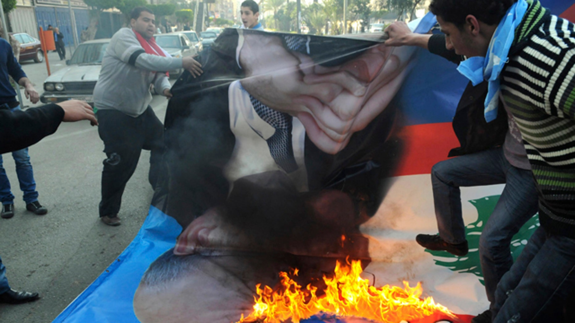 Jan. 25: Angry Sunni protesters burn a poster of former premier Najib Mikati in the northern port city of Tripoli, Lebanon.