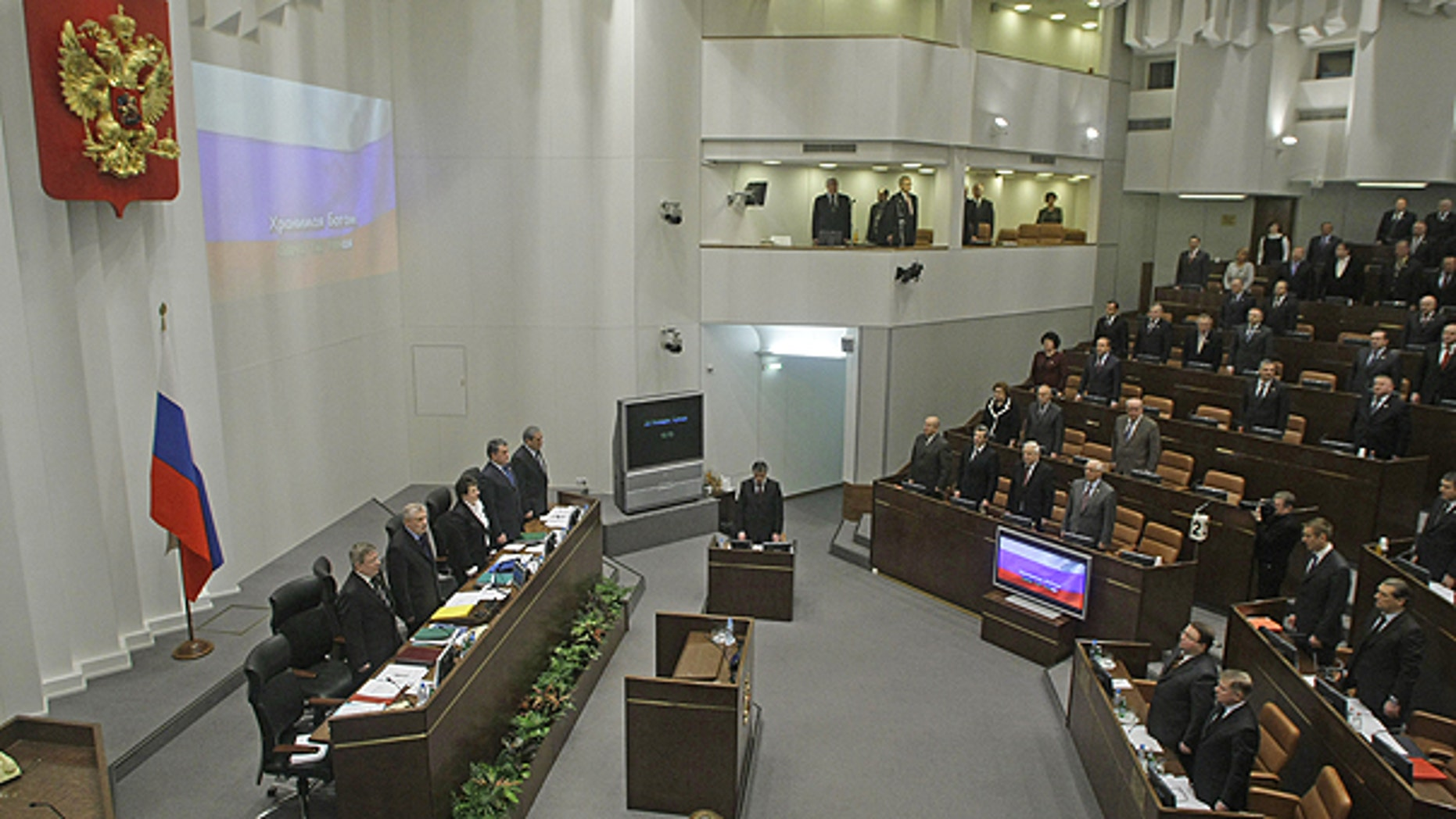Jan. 26: Members of Russia's Federation Council, the upper house of parliament, listen to the Russian national anthem at a parliament session in Moscow, Russia.