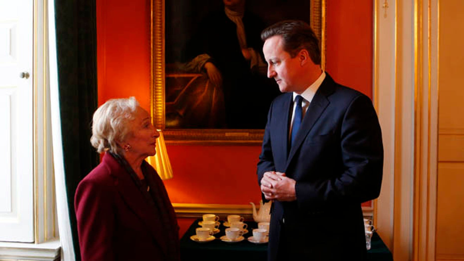 Jan. 21, 2013: British Prime Minister David Cameron talks with Holocaust survivor Freda Wineman ahead of Holocaust Memorial Day   at 10 Downing Street in London.
