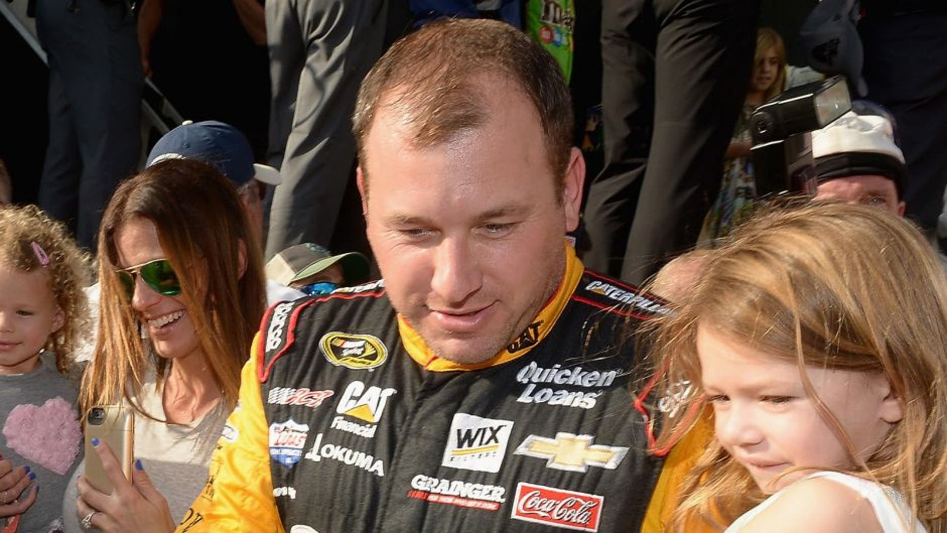 HOMESTEAD, FL - NOVEMBER 22: Ryan Newman and family meet the Minions at NASCAR Ford Championship Weekend in celebration of Minions on digital HD on November 24 and Blu-ray & DVD on December 8. (Photo by Gustavo Caballero/Getty Images For Universal Pictures Home Entertainment)