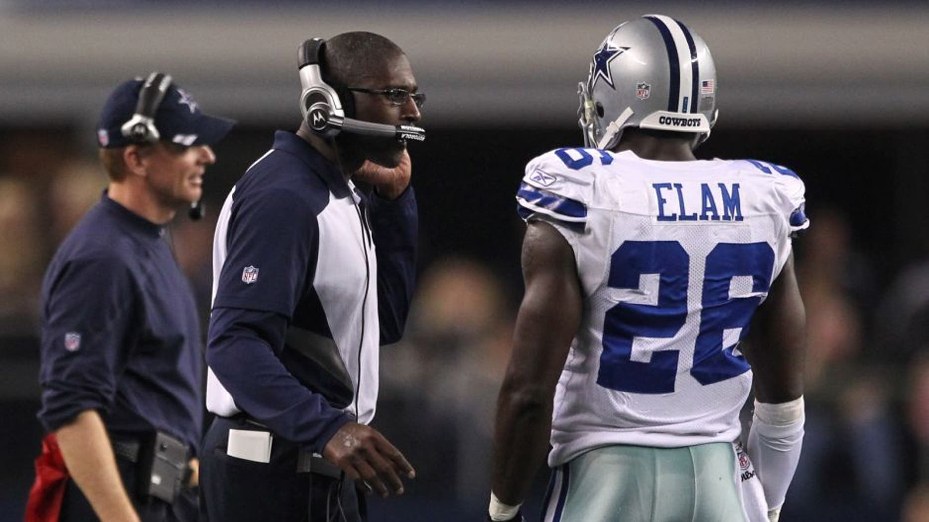 Dec 11, 2011; Dallas, TX, USA; Dallas Cowboys secondary coach Brett Maxie talks with safety Abram Elam (26) with head coach Jason Garrett in the background during a break in the action against the New York Giants at Cowboys Stadium. Mandatory Credit: Matthew Emmons-USA TODAY Sports