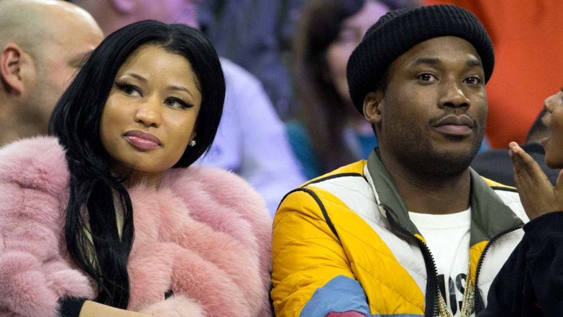 PHILADELPHIA, PA - JANUARY 26: Recording artists Nicki Minaj and Meek Mill look on during the game between the Phoenix Suns and Philadelphia 76ers on January 26, 2016 at the Wells Fargo Center in Philadelphia, Pennsylvania. (Mitchell Leff/Getty Images)