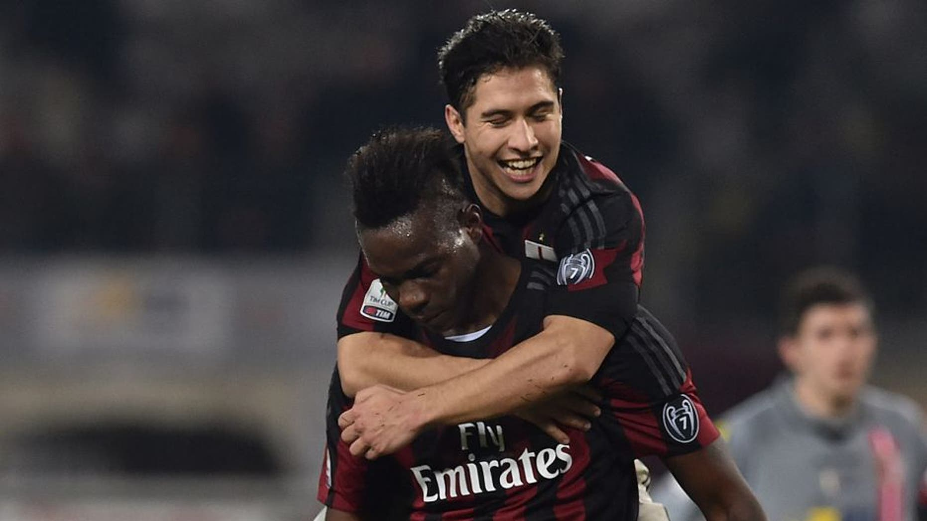 TURIN, ITALY - JANUARY 26: Mario Balotelli (C) of AC Milan celebrates after scoring the opening goal from the penalty spot with team mate Jose Mauri during the TIM Cup match between US Alessandria and AC Milan at Olimpico Stadium on January 26, 2016 in Turin, Italy. (Photo by Valerio Pennicino/Getty Images)