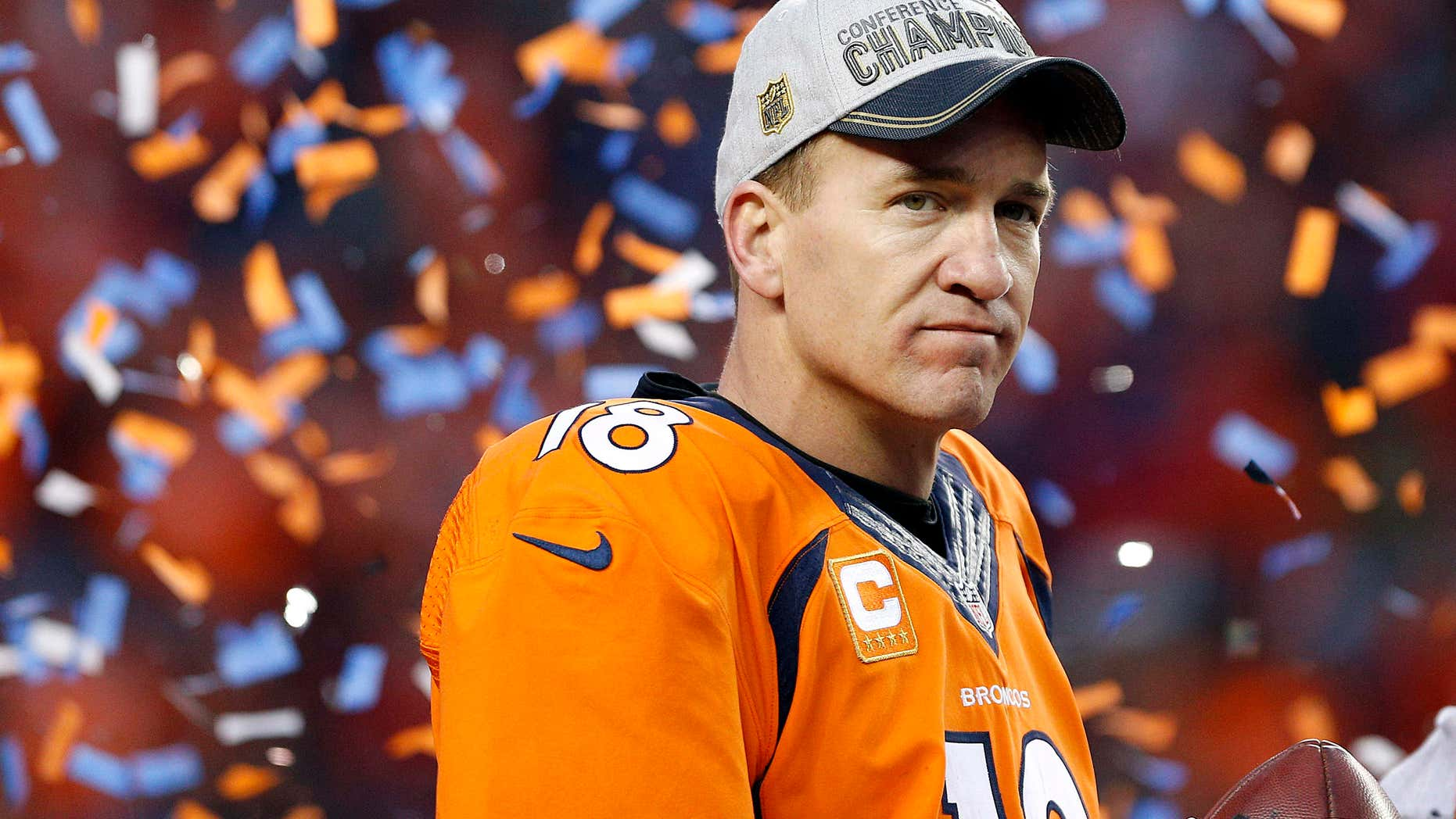 Jan. 24, 2016: Denver Broncos quarterback Peyton Manning watches the AFC championship trophy presentation following the NFL football AFC Championship game between the Denver Broncos and the New England Patriots,.
