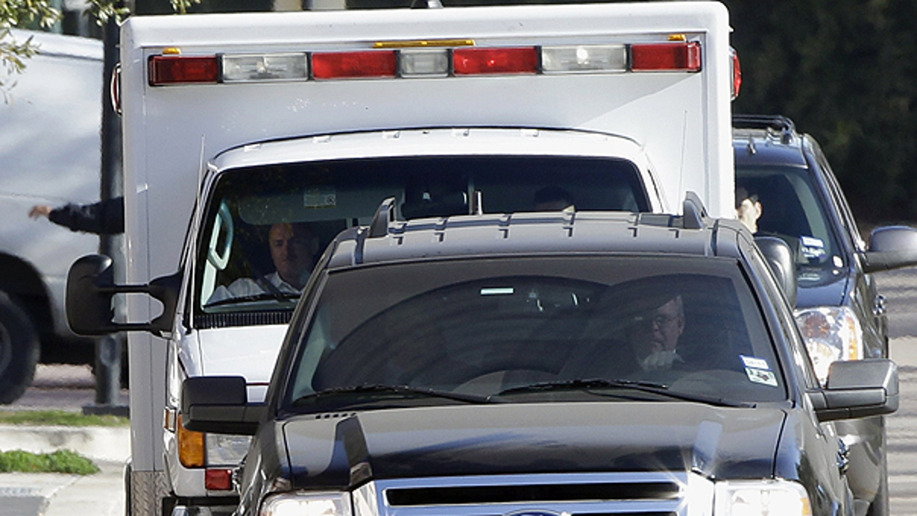Jan. 26: Astronaut Mark Kelly sits in the passenger seat of the ambulance as it carries his wife, U.S. Rep. Gabrielle Giffords, to TIRR Memorial Hermann Rehabilitation Hospital.