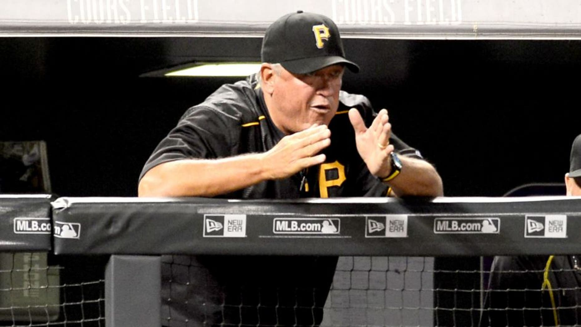 Sep 21, 2015; Denver, CO, USA; Pittsburgh Pirates manager Clint Hurdle (13) calls out from the dugout in the fifth inning against the Colorado Rockies at Coors Field. Mandatory Credit: Ron Chenoy-USA TODAY Sports
