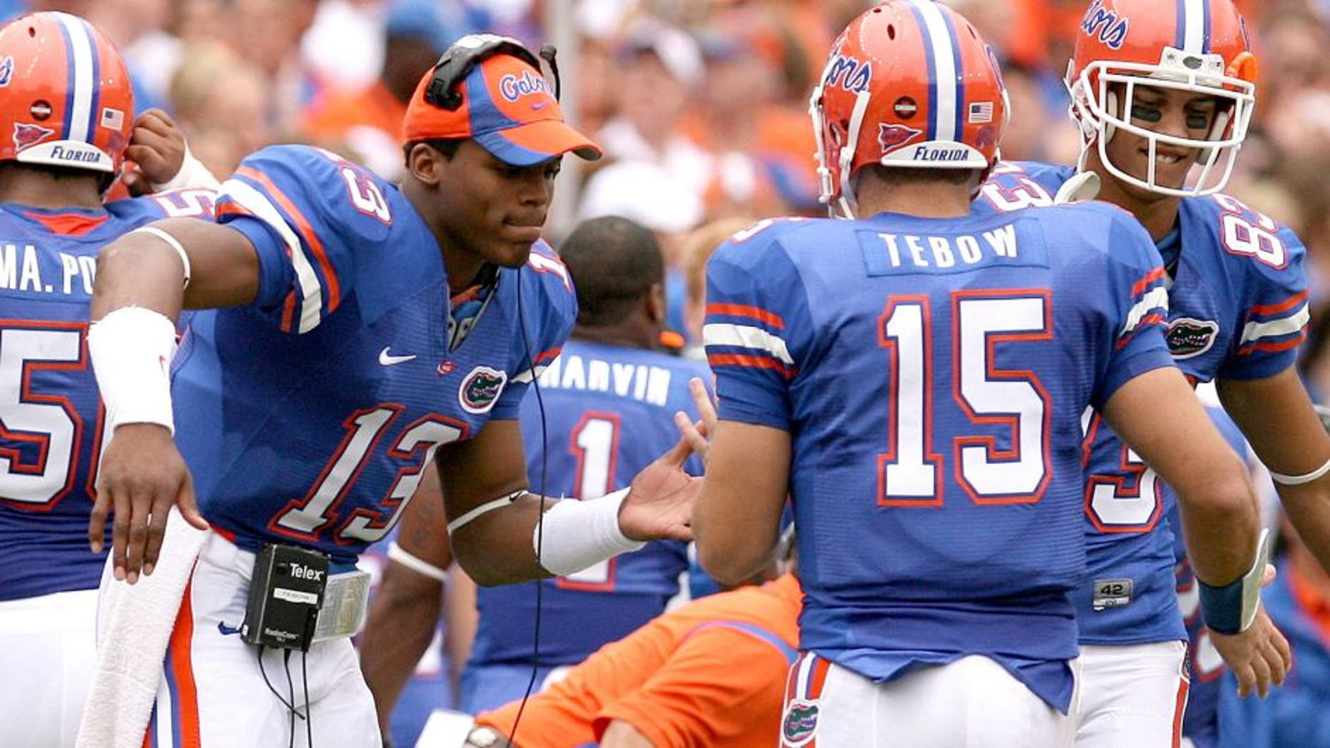 GAINESVILLE, FL - OCTOBER 25, 2008: Tim Tebow, #15 quarterback and Cam Newton, #13 quarterback of the University of Florida Gators football team celebrate on the sideline during the game against the Kentucky Wildcats at Ben Hill Griffin Stadium in Gainesville, Florida on October 25, 2008. The Gators won 63-5. (Photo by Tim Casey/University of Florida/Collegiate Images/Getty Images)