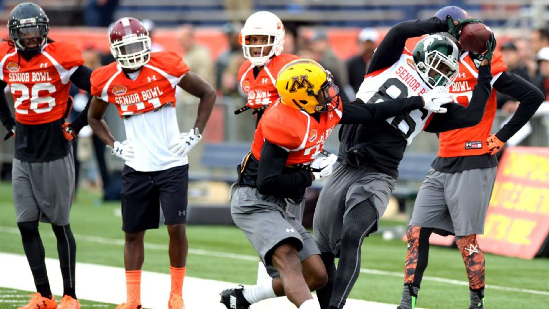 Jan 26, 2016; Mobile, AL, USA; North squad wide receiver Aaron Burbridge of Michigan State (86) makes a catch near the sideline as defensive back Eric Murray of Minnesota (31) defends during Senior Bowl practice at Ladd-Peebles Stadium. Mandatory Credit: Glenn Andrews-USA TODAY Sports