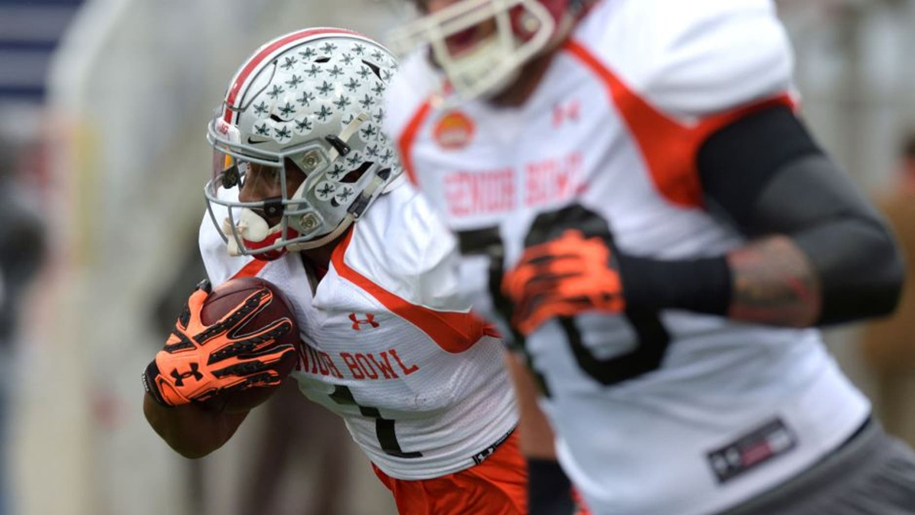 Jan 26, 2016; Mobile, AL, USA; North squad wide receiver Braxton Miller of Ohio State (1) runs the ball after a catch during Senior Bowl practice at Ladd-Peebles Stadium. Mandatory Credit: Glenn Andrews-USA TODAY Sports