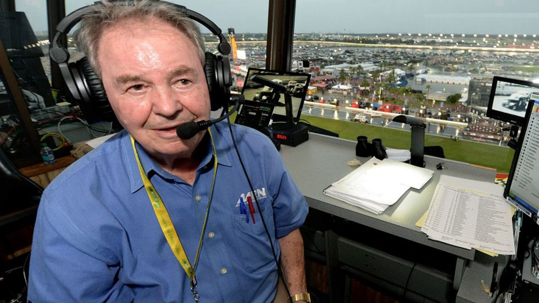 Jul 5, 2014; Daytona Beach, FL, USA; Motor Racing Network radio announcer Barney Hall pauses for a portrait in the radio booth during a rain delay for the Coke Zero 400 at Daytona International Speedway. With more than 50 years of calling races, the 82-year-old Hall will remain a vibrant part of Motor Racing Network broadcasts, but tonight s Coke Zero 400 will be his final as MRN s lead play-by-play announcer in the booth. Mandatory Credit: John David Mercer-USA TODAY Sports