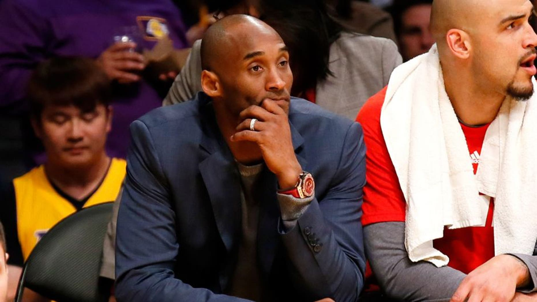 Los Angeles Lakers' Kobe Bryant sits on the bench during the first half of the team's NBA basketball game against the Dallas Mavericks, Tuesday, Jan. 26, 2016, in Los Angeles. (AP Photo/Danny Moloshok)