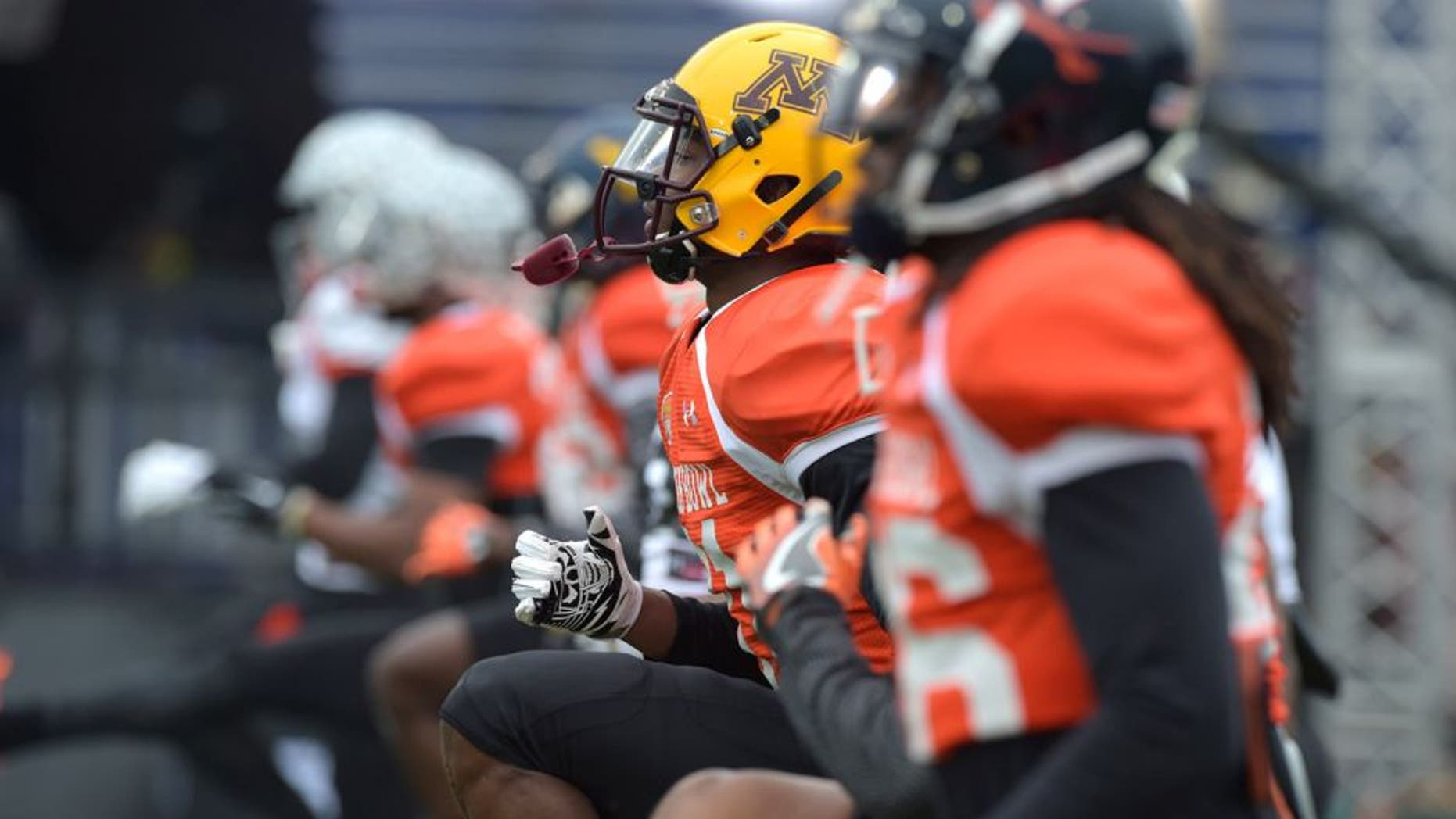 Jan 27, 2016; Mobile, AL, USA; North squad players, including dc Eric Murray of Minnesota (middle) stretch during Senior Bowl practice at Ladd-Peebles Stadium. Mandatory Credit: Glenn Andrews-USA TODAY Sports
