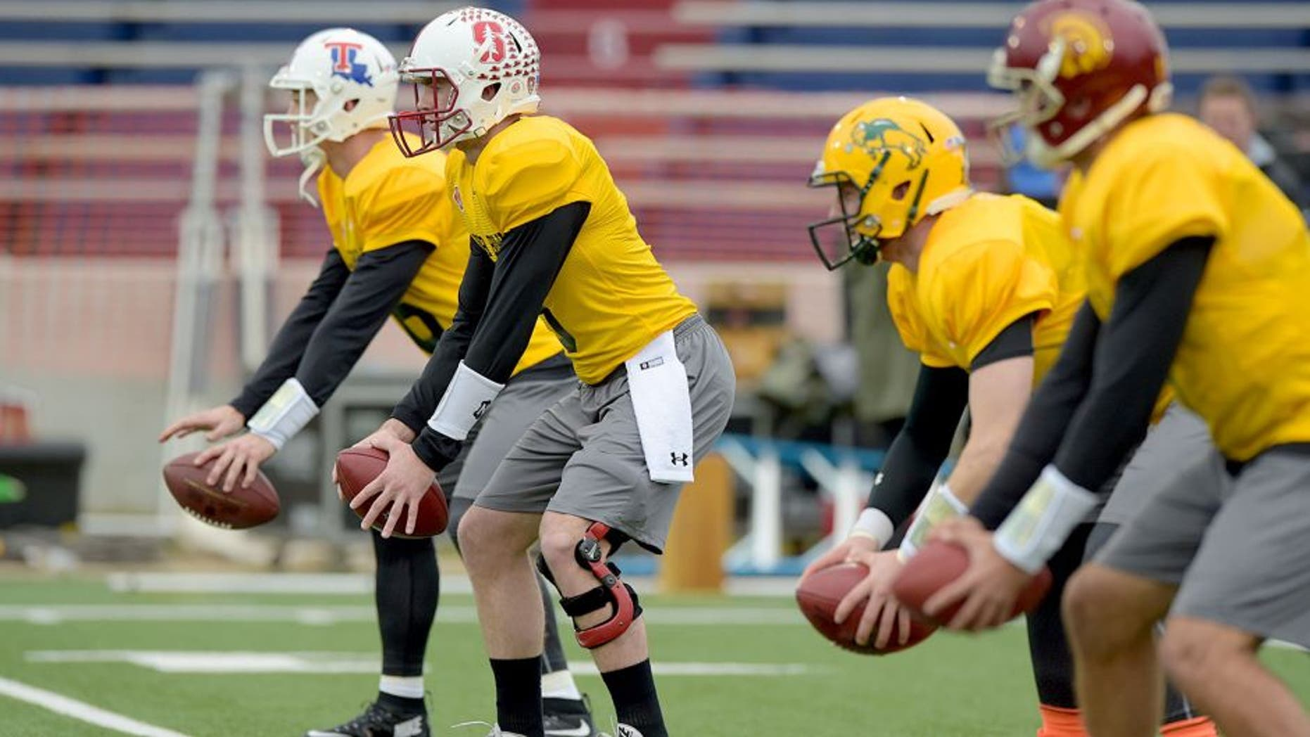 Jan 26, 2016; Mobile, AL, USA; North squad quarterback Jeff Driskel of Louisiana Tech (far left) and quarterback Kevin Hogan of Stanford (left) and quarterback Carson Wentz of North Dakota State (right) and quarterback Cody Kessler of USC (far right) take snaps during Senior Bowl practice at Ladd-Peebles Stadium. Mandatory Credit: Glenn Andrews-USA TODAY Sports