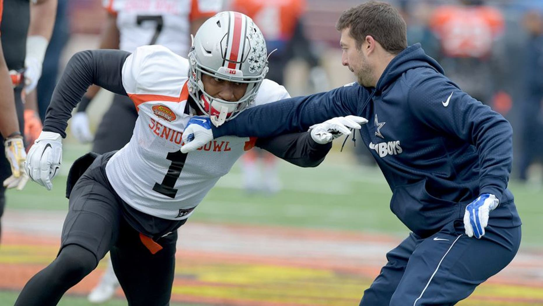 Jan 27, 2016; Mobile, AL, USA; North squad wide receiver Braxton Miller of Ohio State (1) works against a Dallas Cowboys assistant coach on a drill during Senior Bowl practice at Ladd-Peebles Stadium. Mandatory Credit: Glenn Andrews-USA TODAY Sports