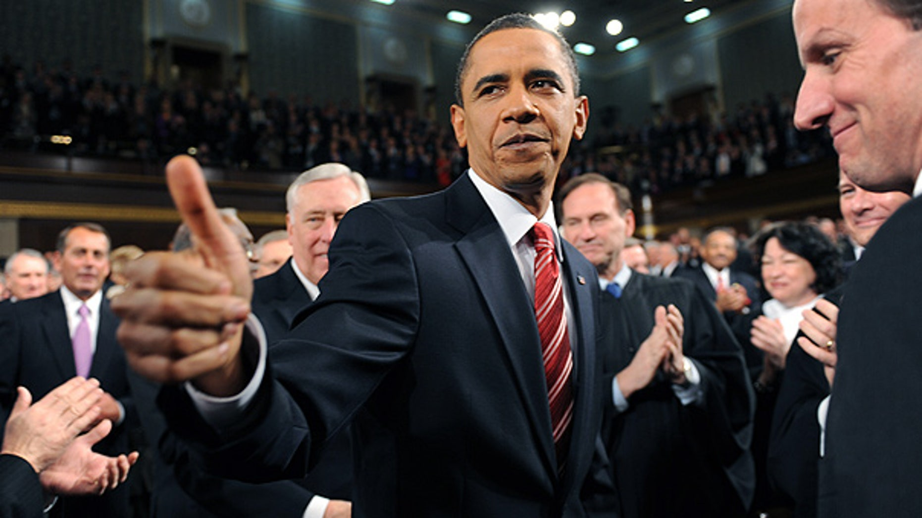 Jan. 27: President Obama greets members of Congress on his way to deliver the State of the Union.