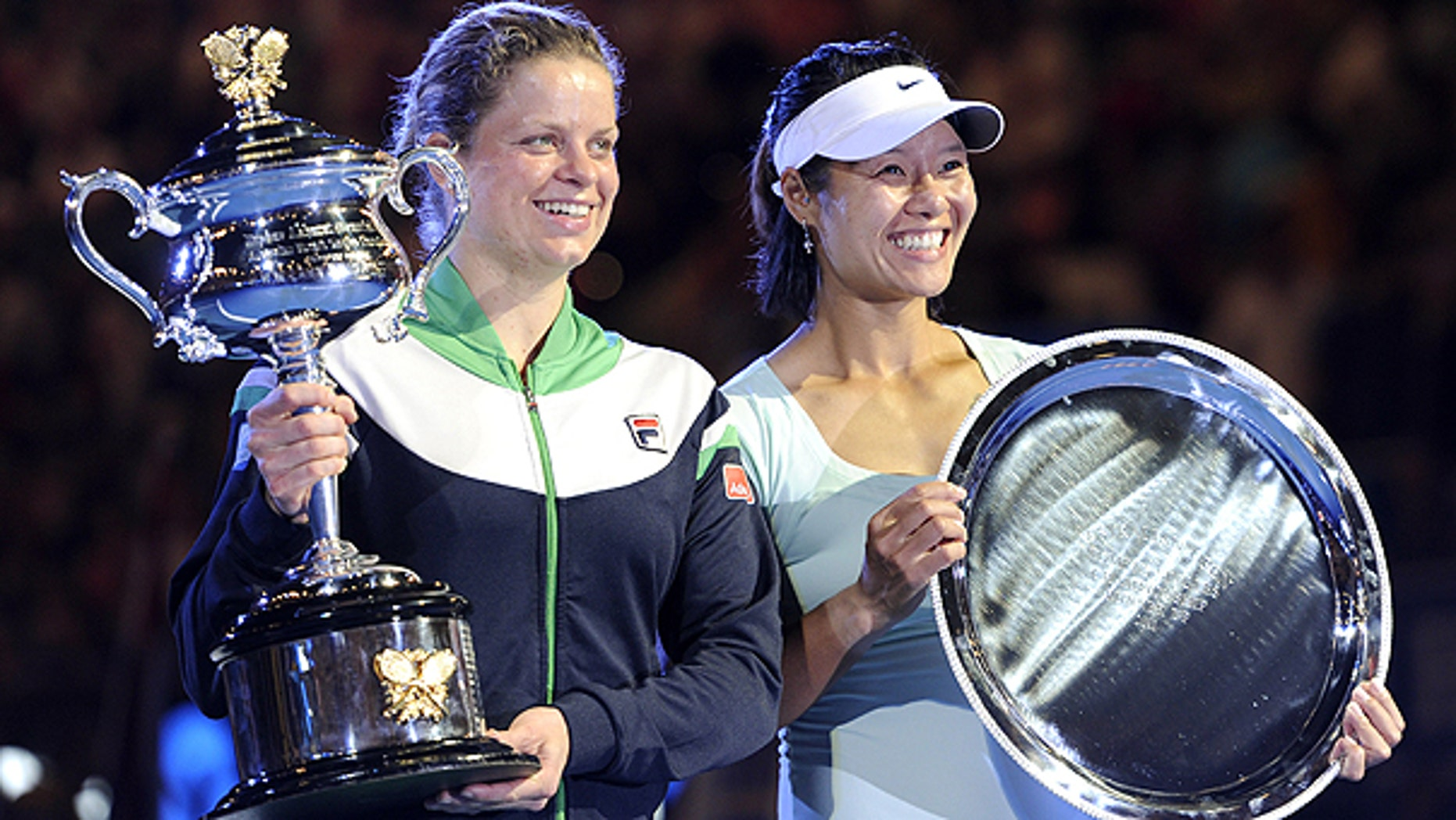 Jan. 29: Belgium's Kim Clijsters, left, holds the trophy along with runner-up China's Li Na look after Clijsters won the women's singles final at the Australian Open tennis championships in Melbourne, Australia.