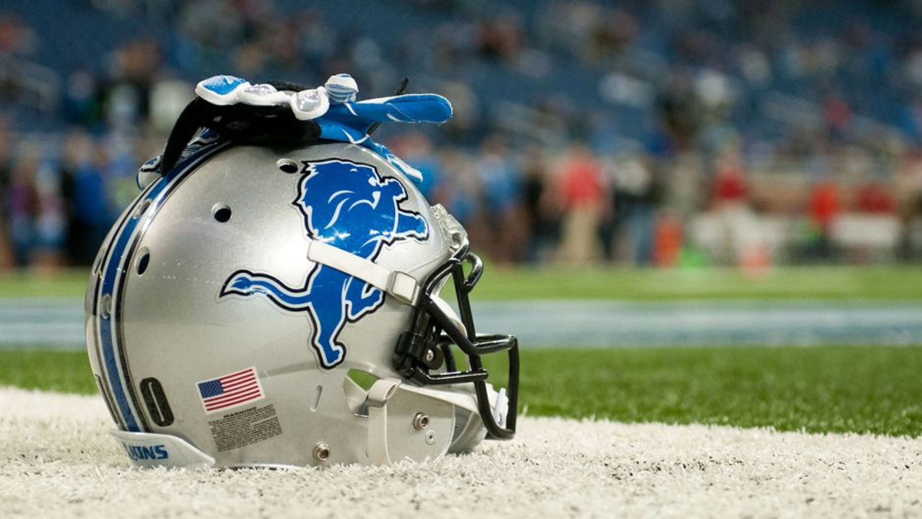 Dec 7, 2014; Detroit, MI, USA; A detailed view of a Detroit Lions helmet and gloves before the game against the Tampa Bay Buccaneers at Ford Field. Mandatory Credit: Tim Fuller-USA TODAY Sports
