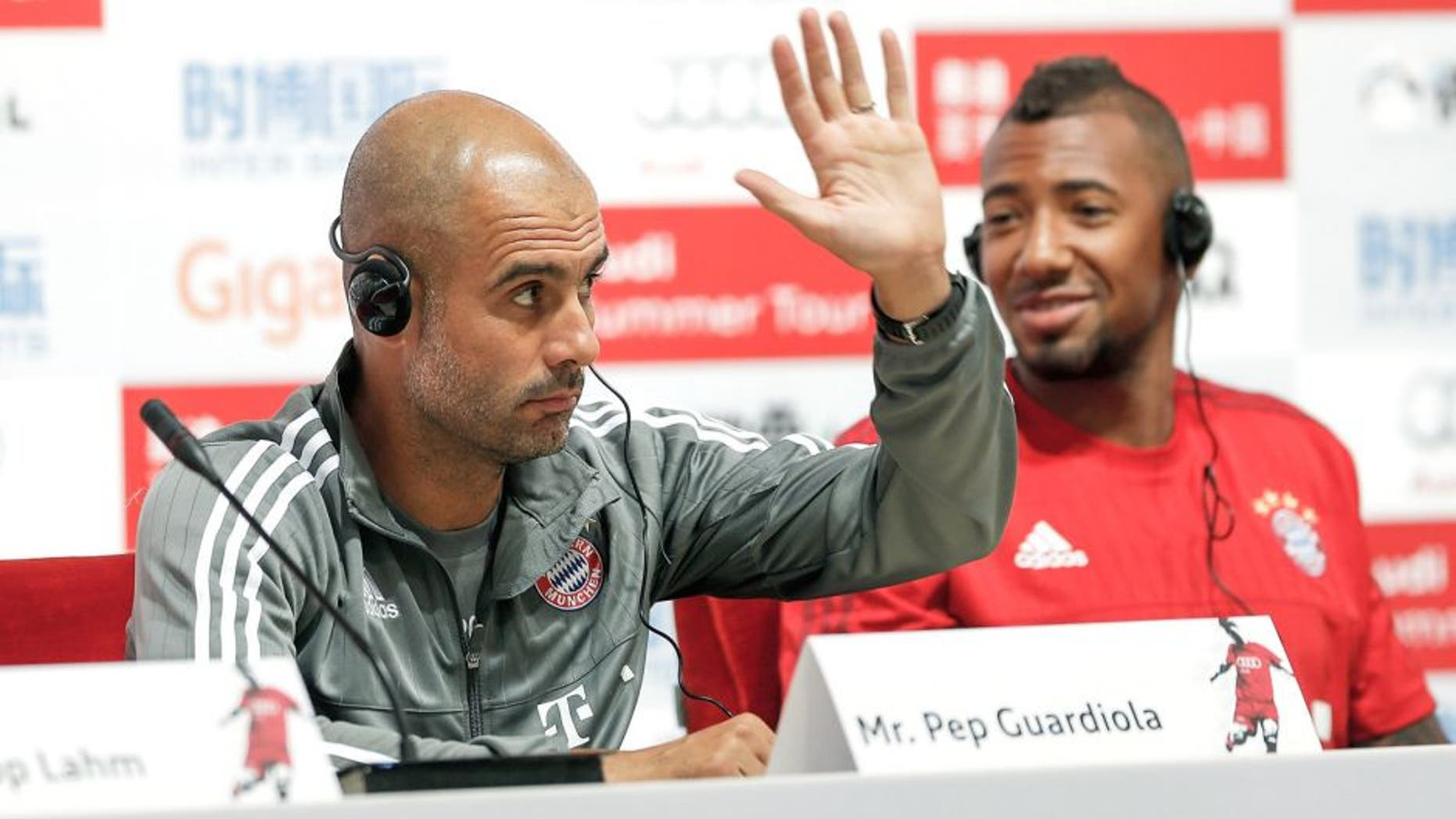 BEIJING, CHINA - JULY 17: Head coach Pep Guardiola of Bayern gestures with Jerome Boateng during the a press conference at National Stadium in day 1 of the FC Bayern Audi China Summer Pre-Season Tour on July 17, 2015 in Beijing, China. (Photo by Lintao Zhang/Getty Images)