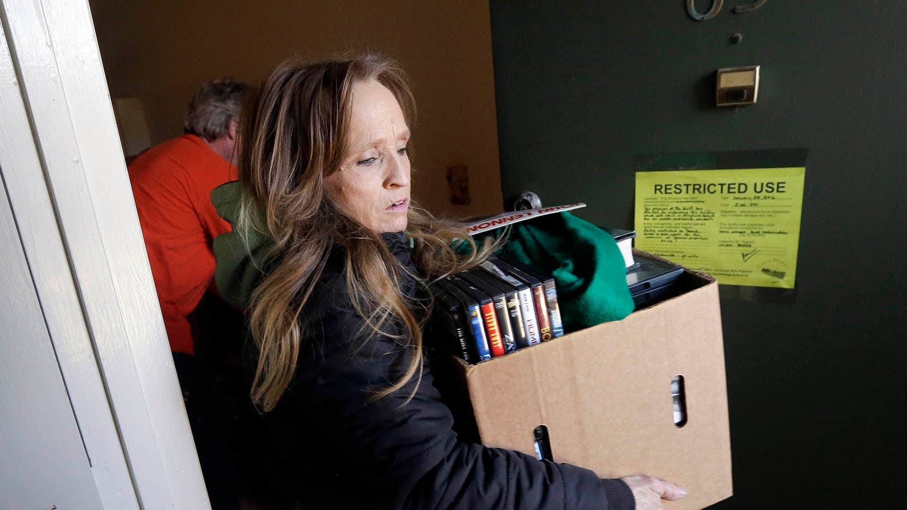 Jan. 27, 2016: Laura Wilsey, center, and friend George Neighbors help Wilsey's brother Jeff Bowman evacuate his apartment in Pacifica, Calif..