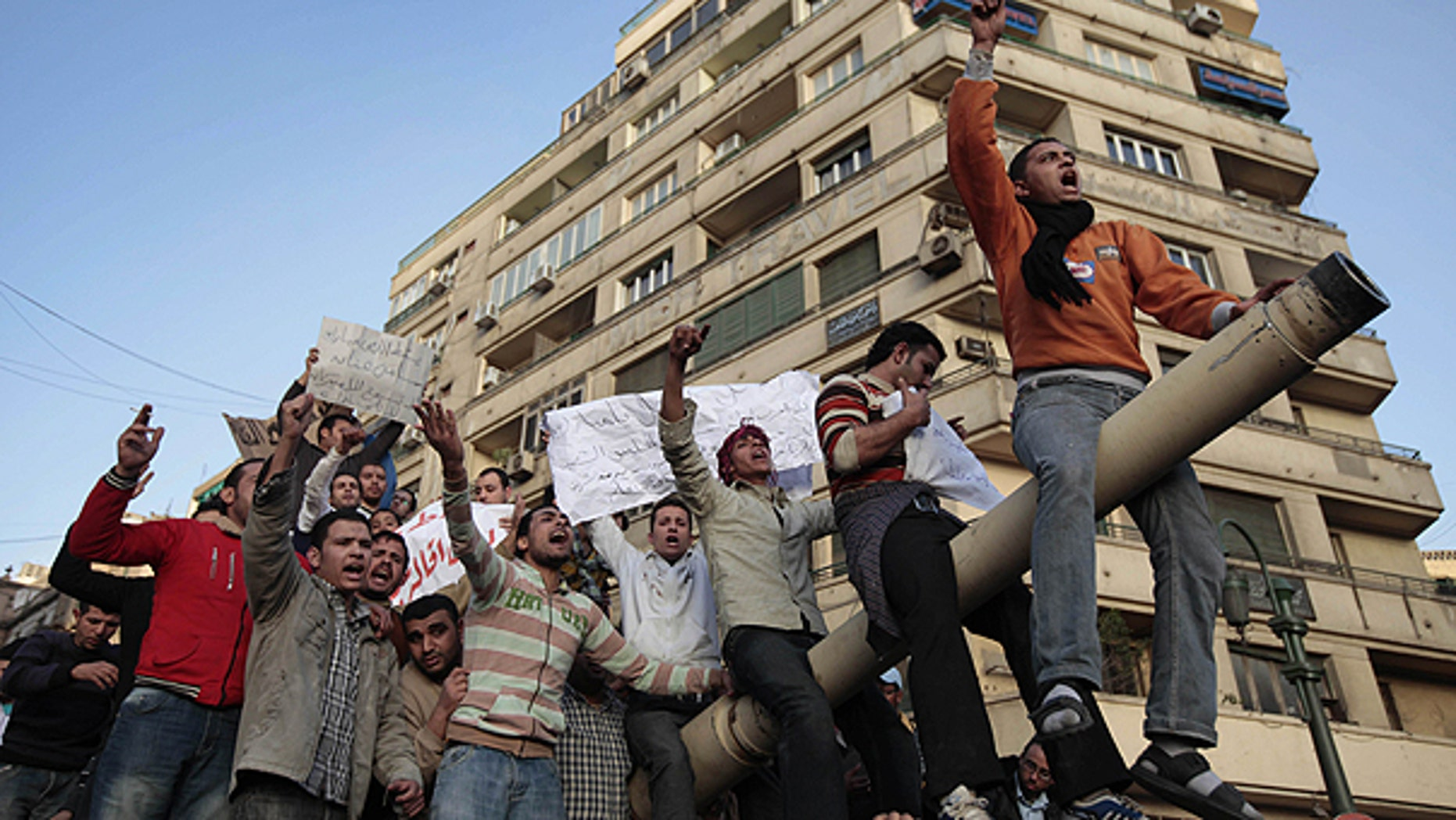 Jan. 29: Egyptian anti-government protesters chant slogans as they stand atop an Egyptian army tank during a protest in Tahrir square in Cairo, Egypt.