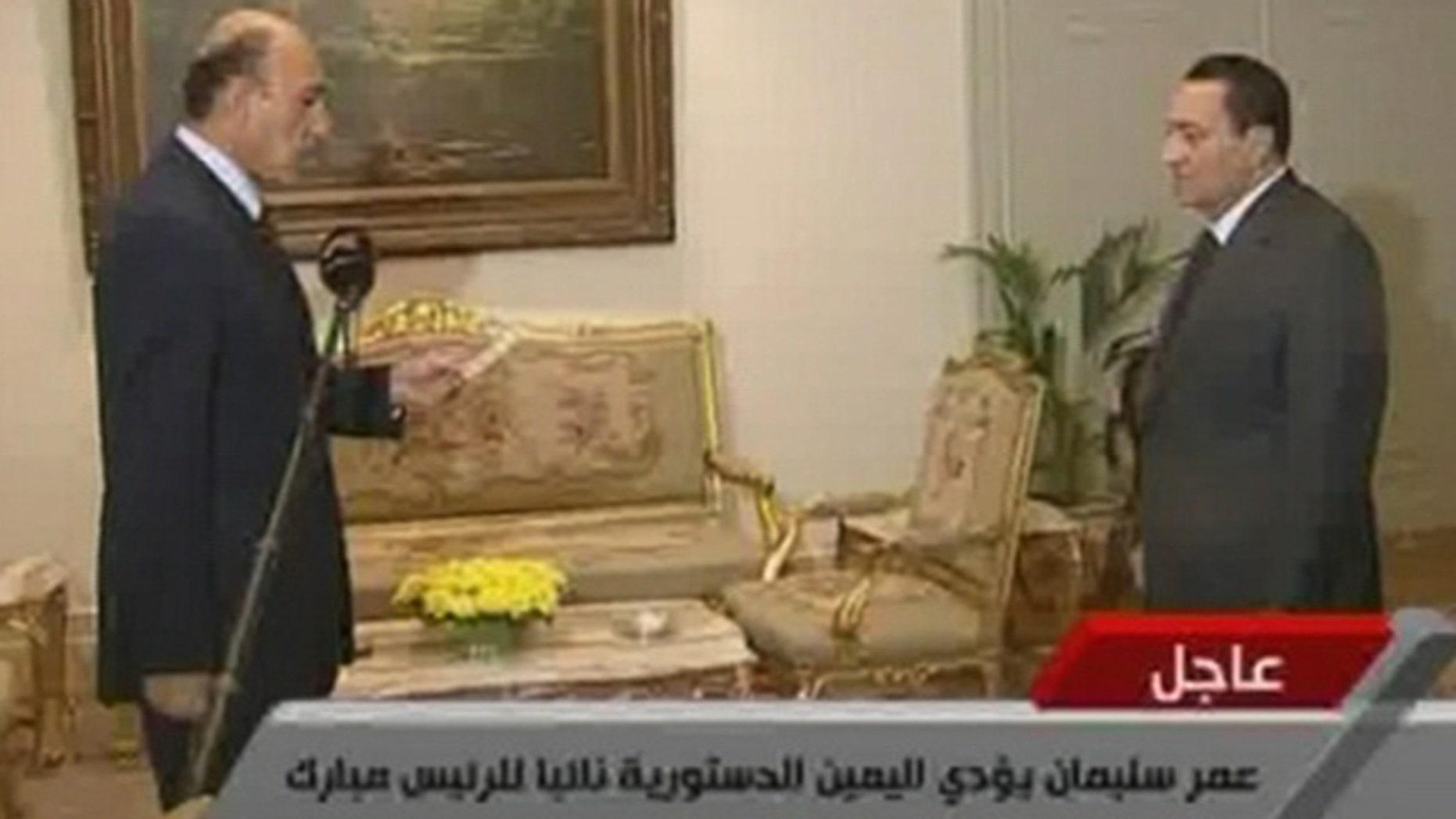 Jan. 29: In this image taken from TV, Egyptian President Hosni Mubarak, right, listens as Omar Suleiman swears the oath as Vice President of Egypt.